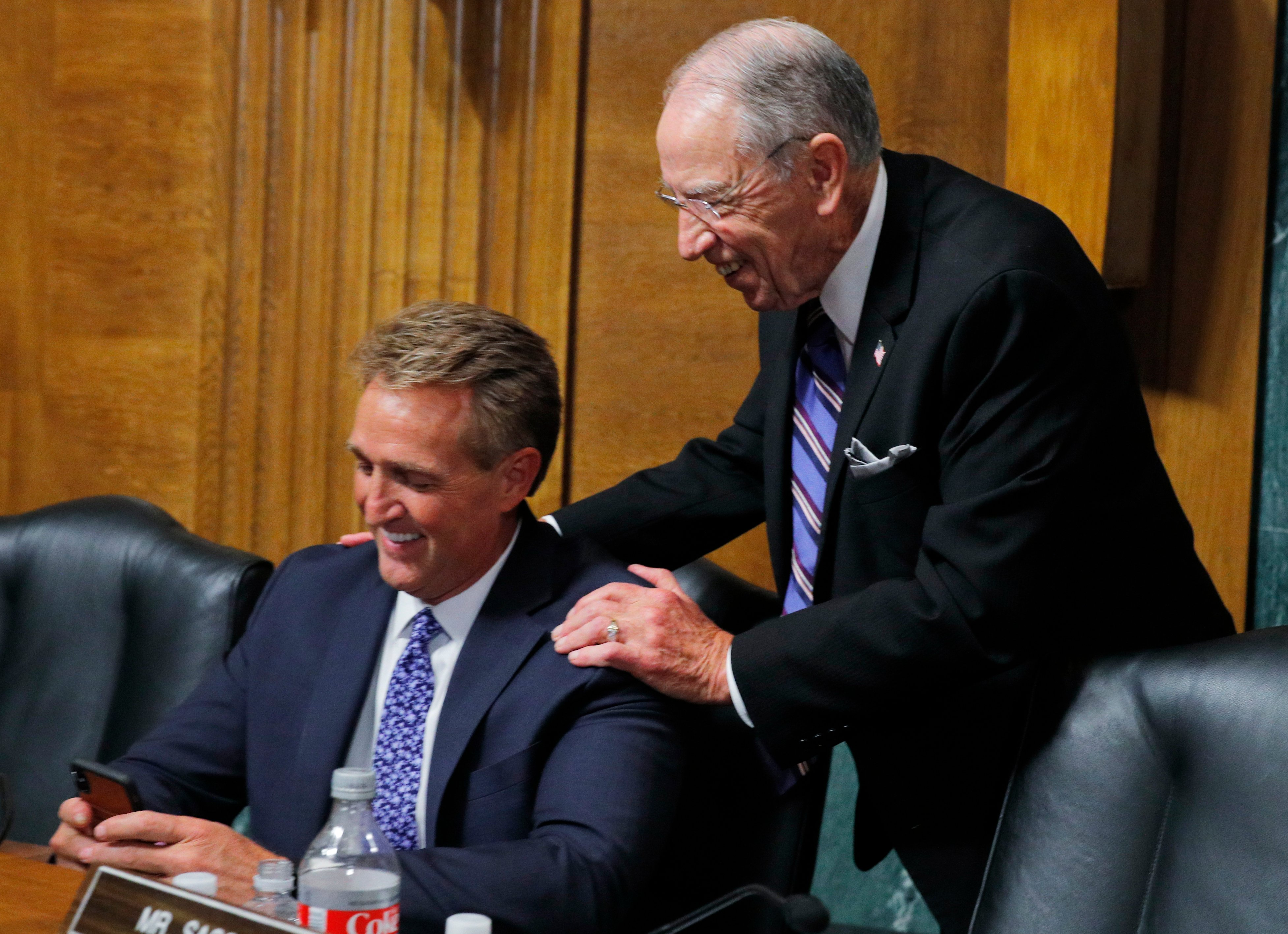 Senator Jeff Flake speaks with Senator Chuck Grassley during Judge Brett Kavanaugh's testimony before the Senate Judiciary Committee during his Supreme Court confirmation hearing in the Dirksen Senate Office Building on Capitol Hill September 27, 2018 (Jim Bourg-Pool/Getty Images)