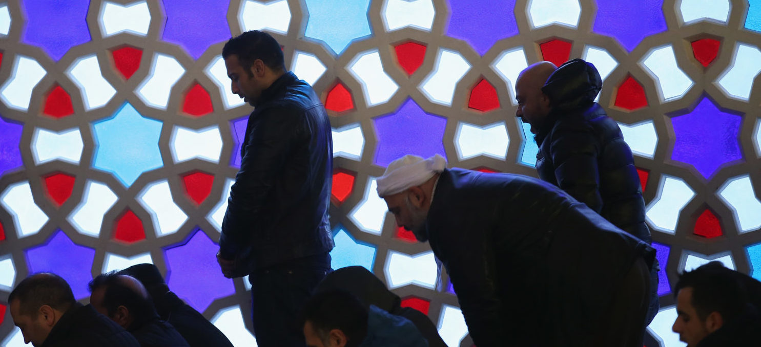 BERLIN, GERMANY - JANUARY 09: Worshippers, standing in front fo a stained-glass window, attend midday Friday prayers at the Turkish-speaking Sehitlik Mosque on January 9, 2015 in Berlin, Germany. (Photo by Sean Gallup/Getty Images)