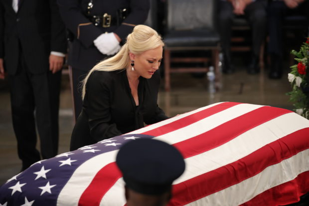 WASHINGTON, DC - AUGUST 31: Meghan McCain, daughter of Sen. John McCain, touches the casket during the ceremony honoring the late US Senator inside the Rotunda of the U.S. Capitol, August 31, 2018 in Washington, D.C. The late senator died August 25 at the age of 81 after a long battle with brain cancer. He will lie in state at the U.S. Capitol Friday, a rare honor bestowed on only 31 people in the past 166 years. Sen. McCain will be buried at his final resting place at the U.S. Naval Academy on Sunday. (Photo by Drew Angerer/Getty Images)