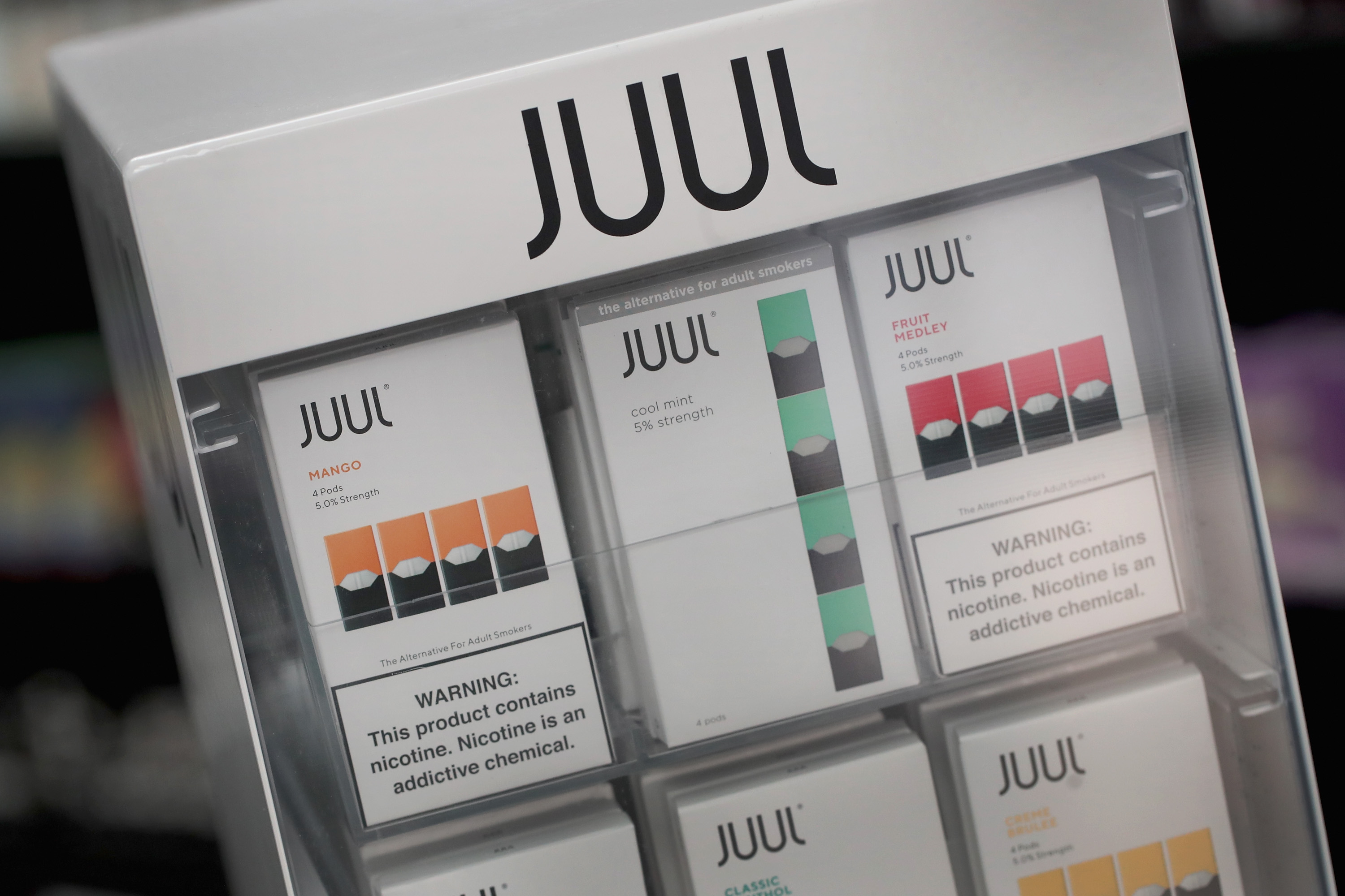 Electronic cigarettes and pods by Juul, the nation's largest maker of vaping products, are offered for sale at the Smoke Depot on September 13, 2018 in Chicago, Illinois. Scott Olson/Getty Images