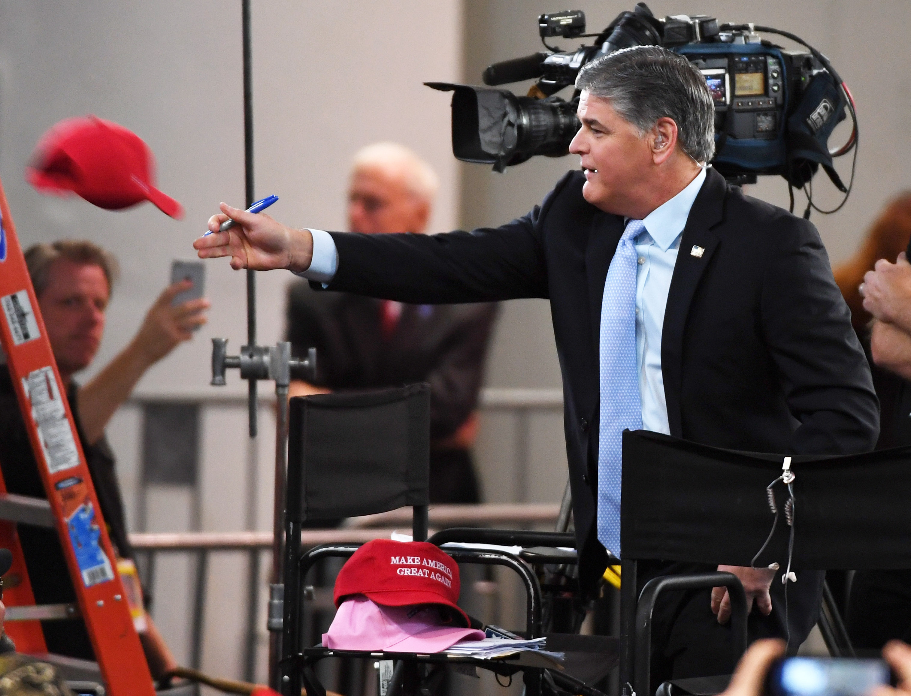 LAS VEGAS, NV - SEPTEMBER 20: Fox News Channel and radio talk show host Sean Hannity throws a Trump hat that he autographed to an attendee before a Donald Trump campaign rally at the Las Vegas Convention Center on September 20, 2018 in Las Vegas, Nevada. Trump is in town to support the re-election campaign for U.S. Sen. Dean Heller (R-NV) as well as Nevada Attorney General and Republican gubernatorial candidate Adam Laxalt and candidate for Nevada's 3rd House District Danny Tarkanian and 4th House District Cresent Hardy. (Photo by Ethan Miller/Getty Images)
