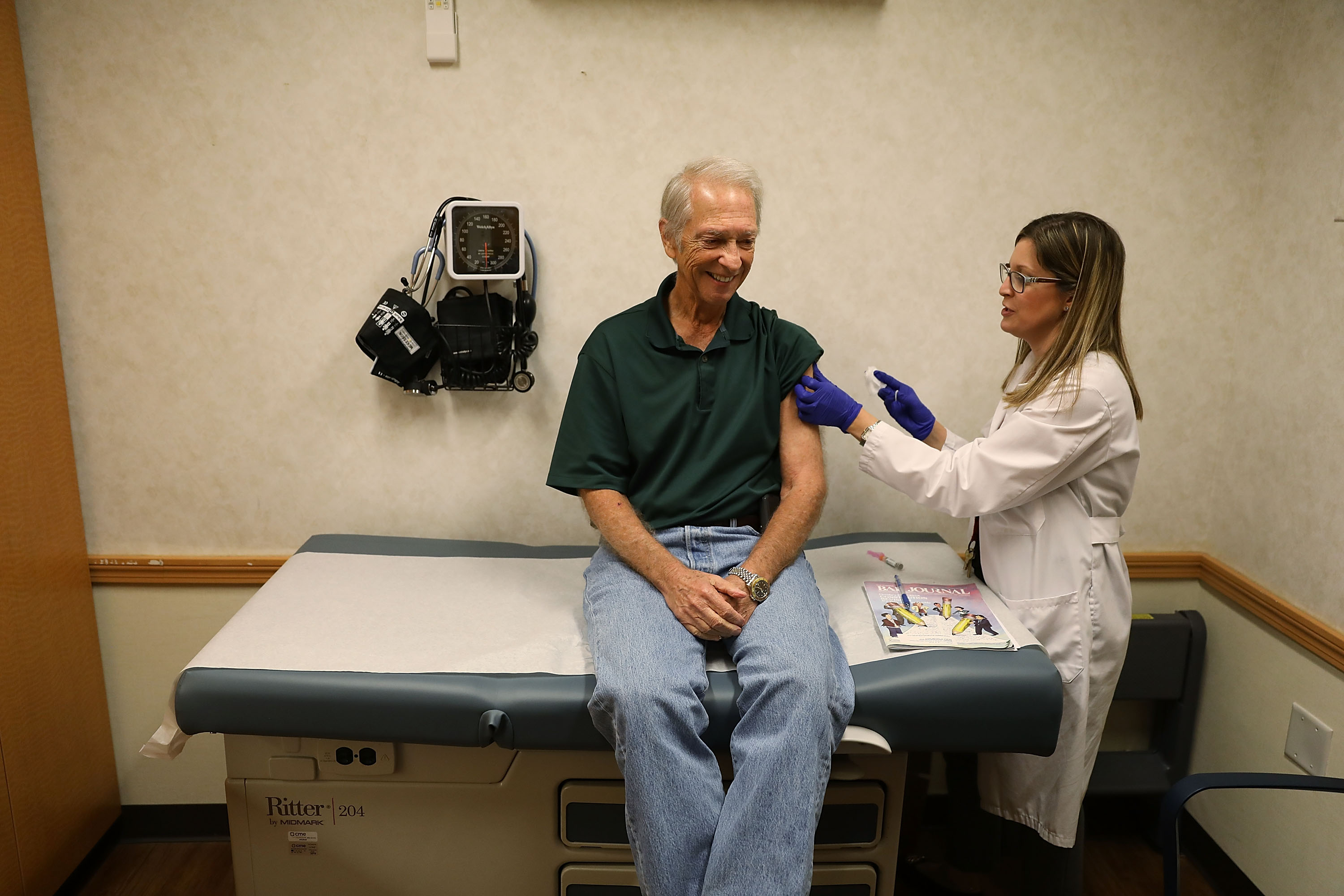Stuart Goldstein receives an influenza vaccination from nurse practitioner, Katherine Male, at the CVS Pharmacy store's MinuteClinic on October 4, 2018 in Miami, Florida. Joe Raedle/Getty Images