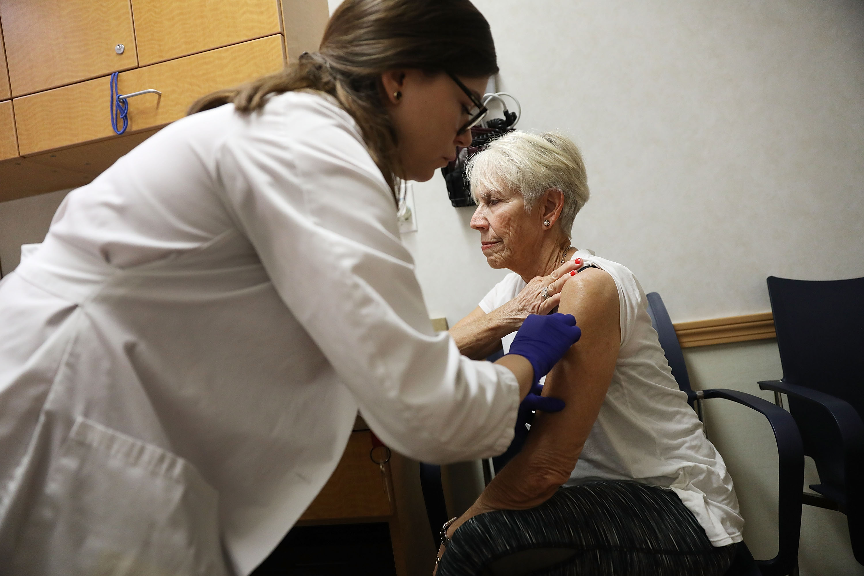 Luanne Boiko receives an influenza vaccination from nurse practitioner, Leslie Suarez, at the CVS Pharmacy store's MinuteClinic on October 4, 2018 in Miami, Florida. Joe Raedle/Getty Images