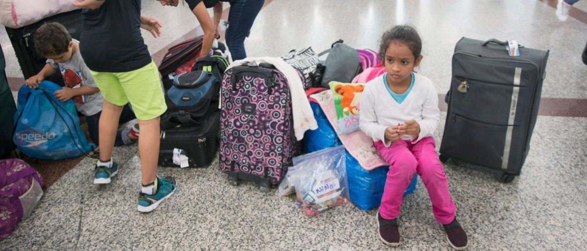 A girl rests at the Santo Domingo airport, while waiting to return to Venezuela, on October 6, 2018. - A group of about 80 Venezuelans who had emigrated to the Dominican Republic to escape the economic crisis in their country left to Venezuela on a flight financed by the Venezuelan government. (Photo by Erika SANTELICES / AFP) (Photo credit should read ERIKA SANTELICES/AFP/Getty Images)