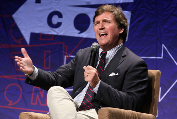 LOS ANGELES, CA - OCTOBER 21: Tucker Carlson speaks onstage during Politicon 2018 at Los Angeles Convention Center on October 21, 2018 in Los Angeles, California. (Photo by Phillip Faraone/Getty Images for Politicon)