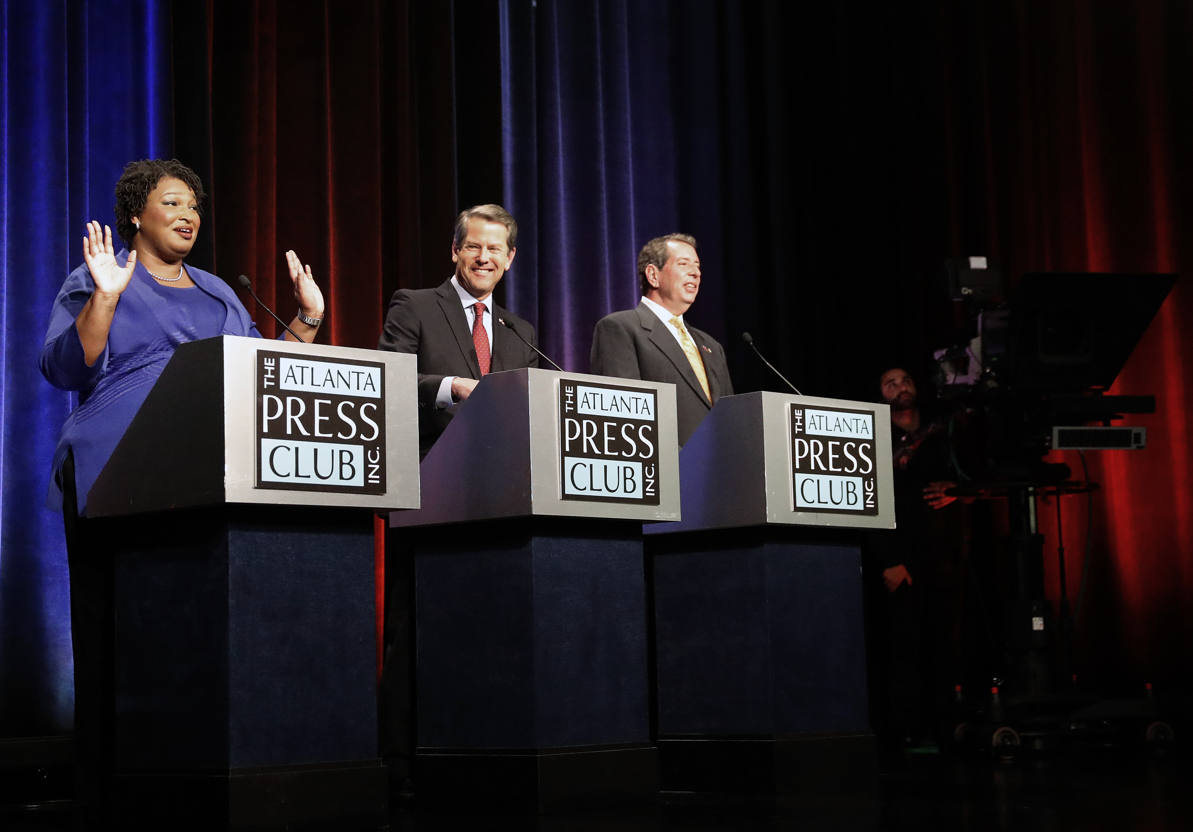 Georgia gubernatorial candidates (L-R) Democrat Stacey Abrams, Republican Brian Kemp and Libertarian Ted Metz react as a fire alarm interrupts their debate at Georgia Public Broadcasting in Midtown October 23, 2018 in Atlanta, Georgia. John Bazemore-Pool/Getty Images