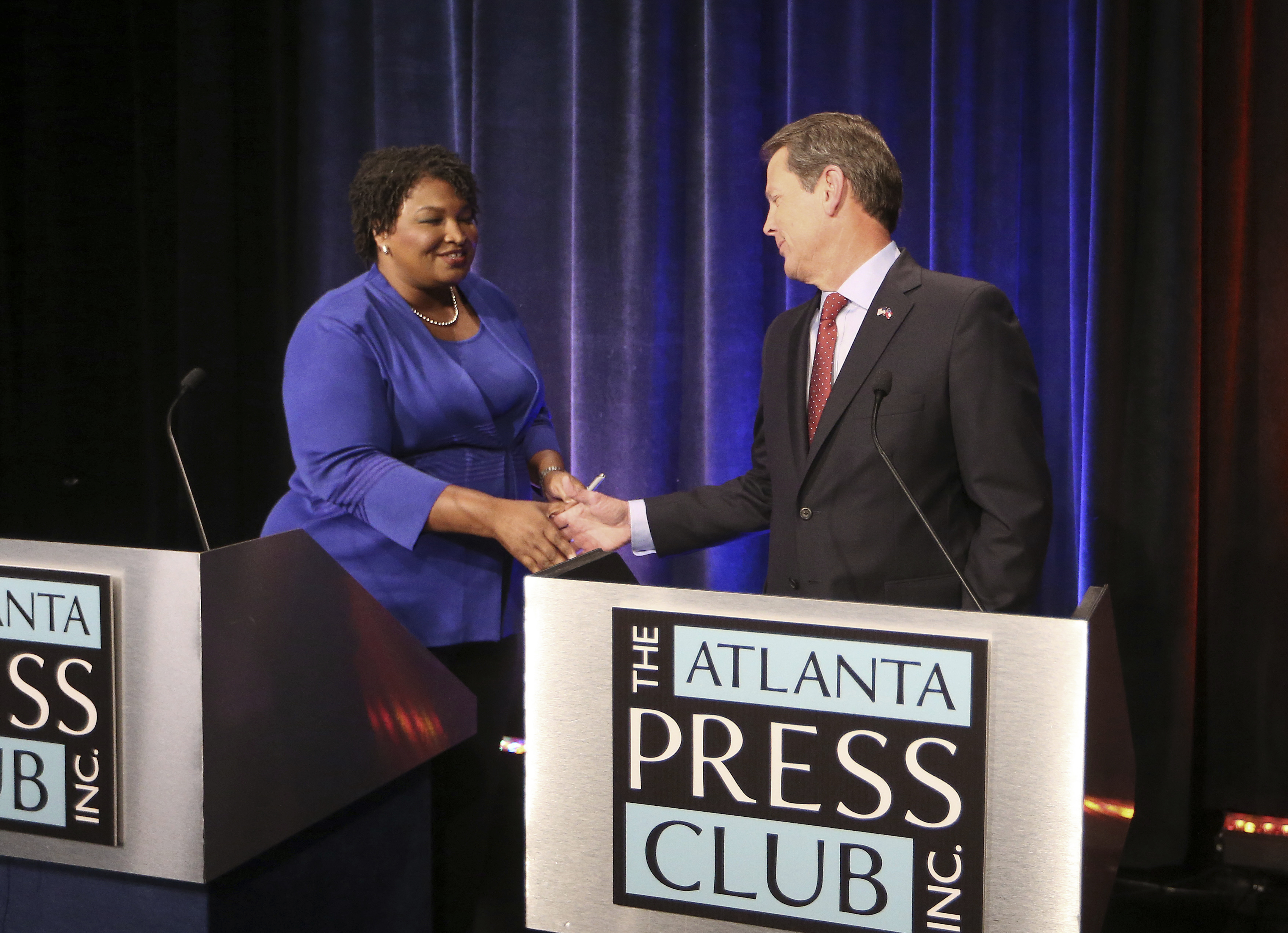 Georgia gubernatorial candidates (L-R) Democrat Stacey Abrams and Republican Brian Kemp shake hands before a debate at Georgia Public Broadcasting in Midtown Oct. 23, 2018 in Atlanta, Georgia. (Photo by John Bazemore-Pool/Getty Images)