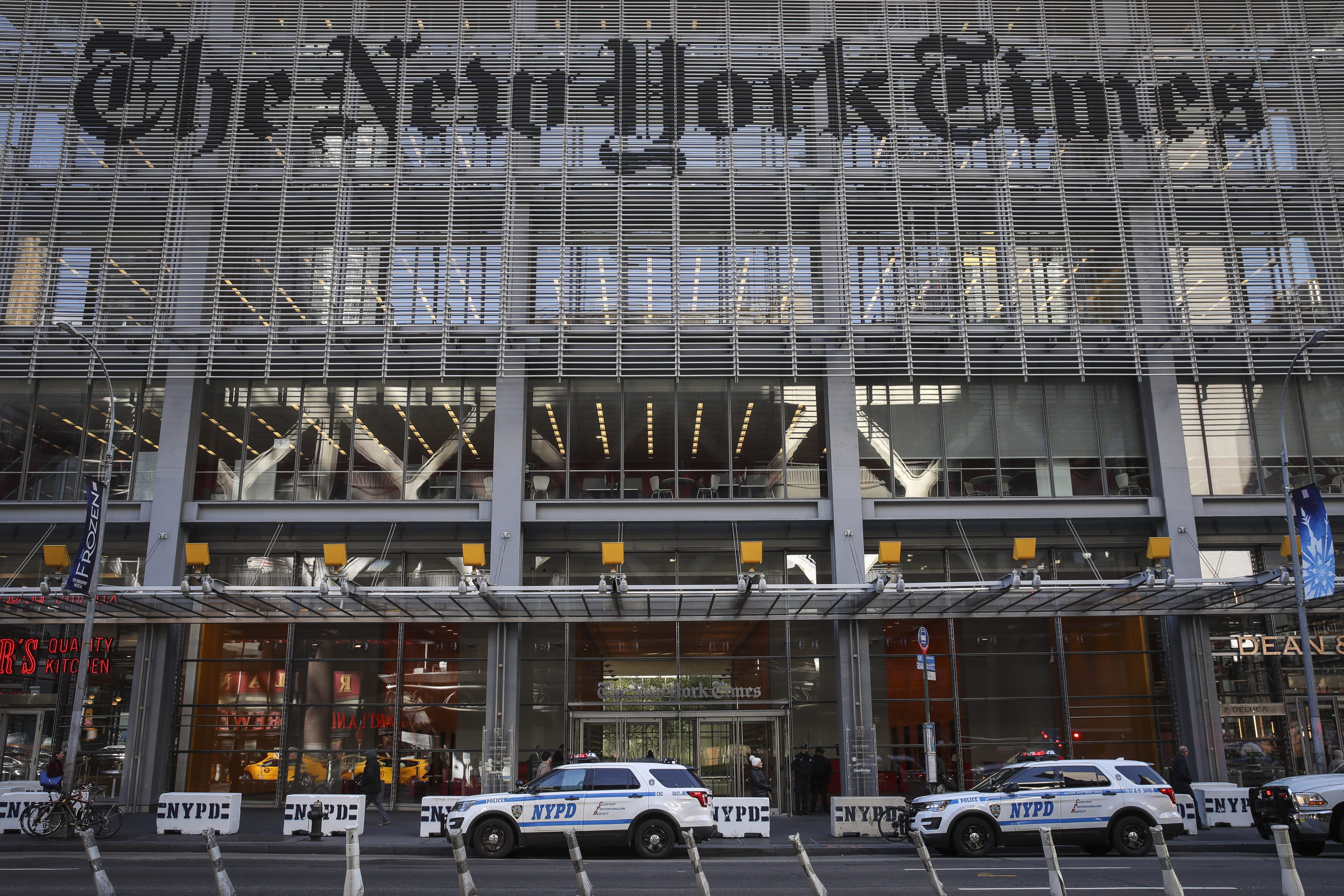 NEW YORK, NY - OCTOBER 25: New York City Police vehicles sit parked outside the office of the The New York Times, October 25, 2018 in New York City. Security is being ramped up in New York City after explosive devices were sent to top Democratic politicians and to CNN headquarters. (Photo by Drew Angerer/Getty Images)