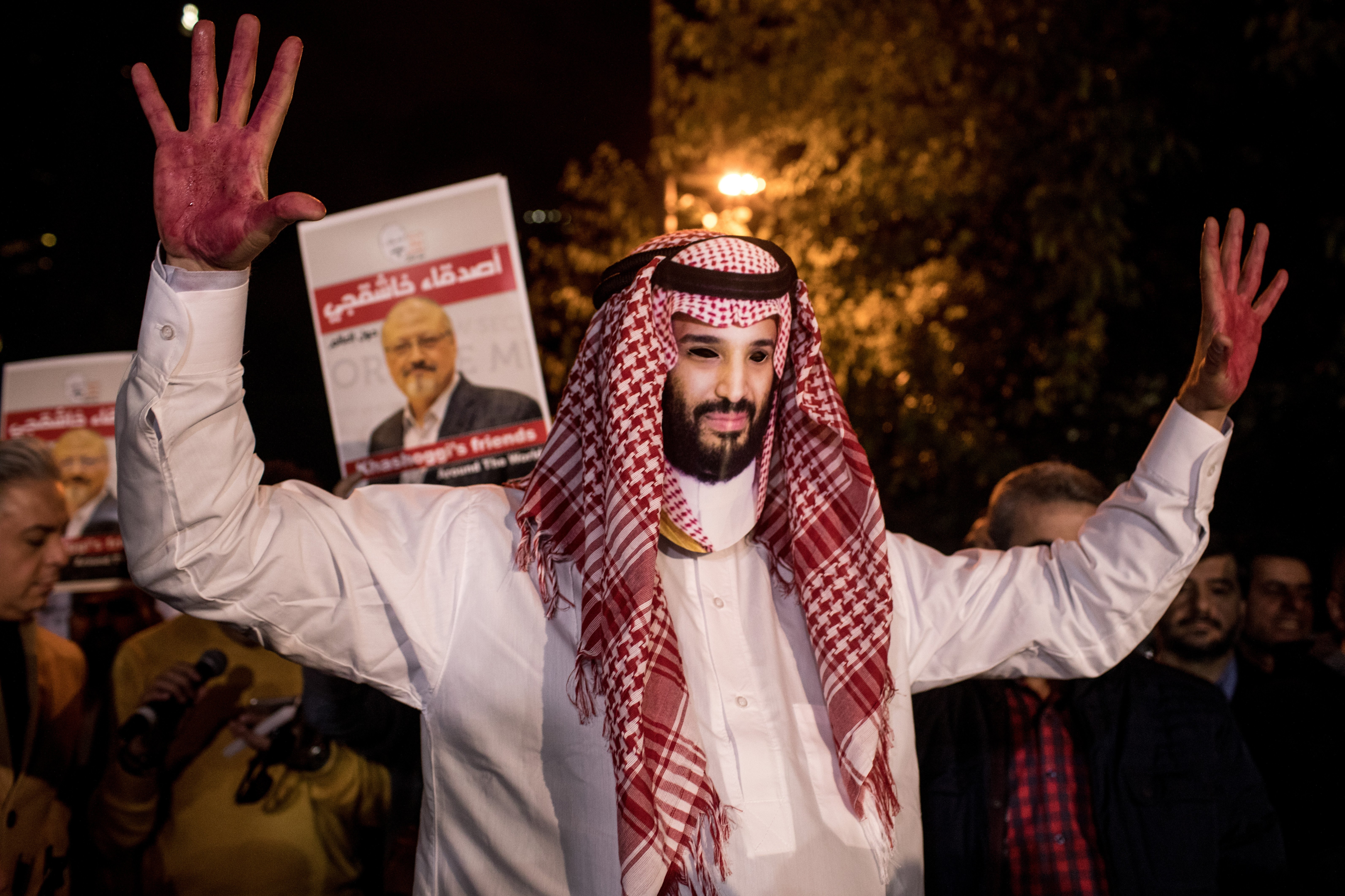 ISTANBUL, TURKEY - OCTOBER 25: A protestor dressed as Saudi Crown Prince Mohammad Bin Salman poses for photographs during a candle light vigil to remember journalist Jamal Khashoggi outside the Saudi Arabia consulate on October 25, 2018 in Istanbul, Turkey. Jamal Khashoggi, a U.S. resident and critic of the Saudi regime, went missing after entering the Saudi Arabian consulate in Istanbul on October 2. More than two weeks later Riyadh announced he had been killed accidentally during an altercation with Saudi consulate officials, however as investigations continue new information surfaced, pointing to a brutal and planned murder contradicting previous claims. (Photo by Chris McGrath/Getty Images)