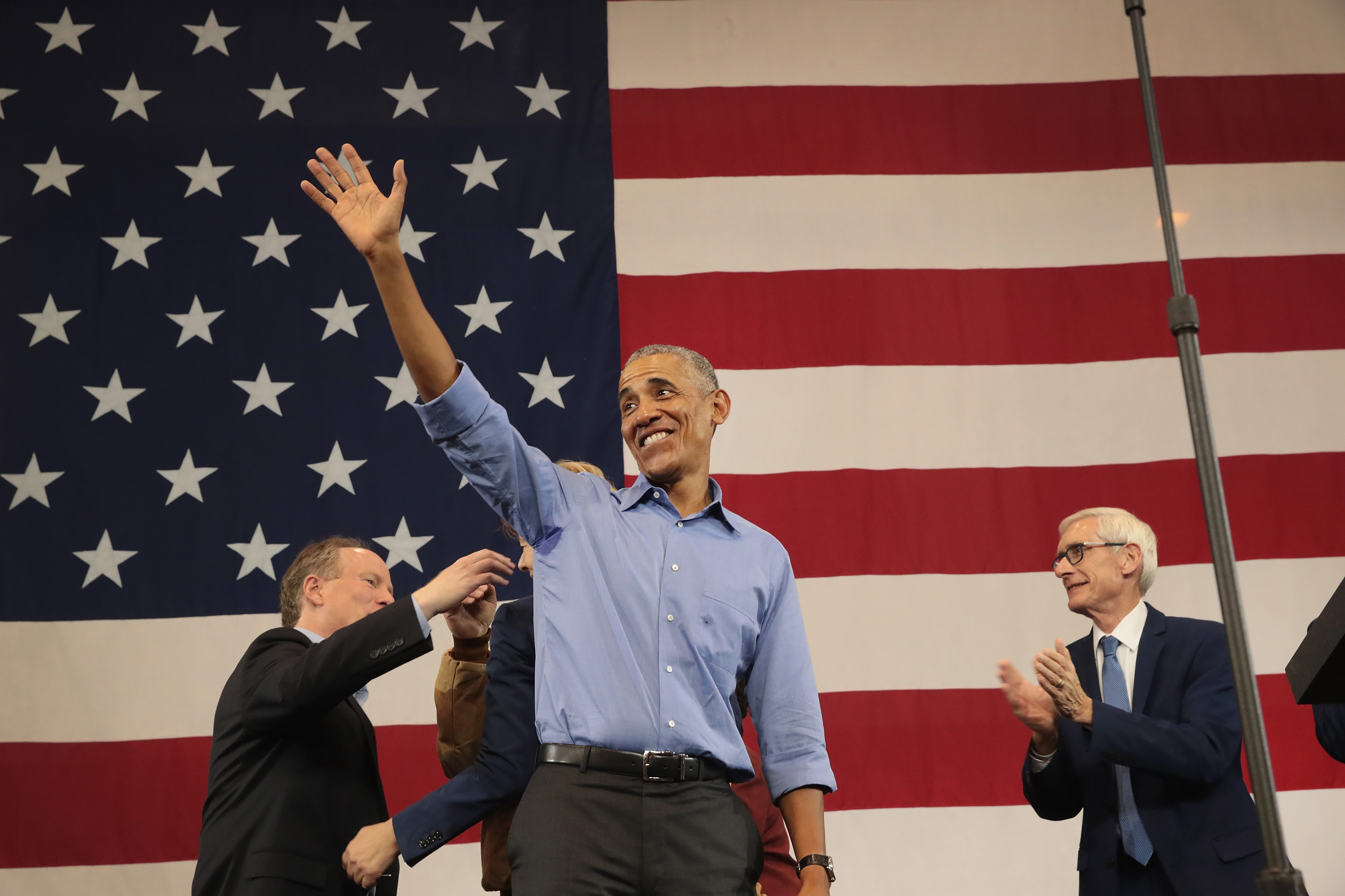 Former President Barack Obama campaigns for Wisconsin Democratic candidates including Tony Evers (far right), Democratic candidate for governor of Wisconsin, during a rally at North Division High School on October 26, 2018 in Milwaukee, Wisconsin. Scott Olson/Getty Images