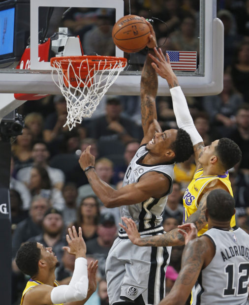 SAN ANTONIO,TX - OCTOBER 27: DeMar DeRozan #10 of the San Antonio Spurs dunks in front of Kyle Kuzma #0 of the Los Angeles Lakers at AT&T Center on October 27 , 2018 in San Antonio, Texas. NOTE TO USER: User expressly acknowledges and agrees that , by downloading and or using this photograph, User is consenting to the terms and conditions of the Getty Images License Agreement. (Photo by Ronald Cortes/Getty Images)