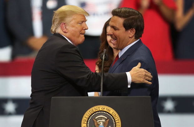 ESTERO, FL - OCTOBER 31: President Donald Trump greets Florida Republican gubernatorial candidate Ron DeSantis during a campaign rally at the Hertz Arena on October 31, 2018 in Estero, Florida. President Trump continues traveling across America to help get the vote out for Republican candidates running for office. (Photo by Joe Raedle/Getty Images)