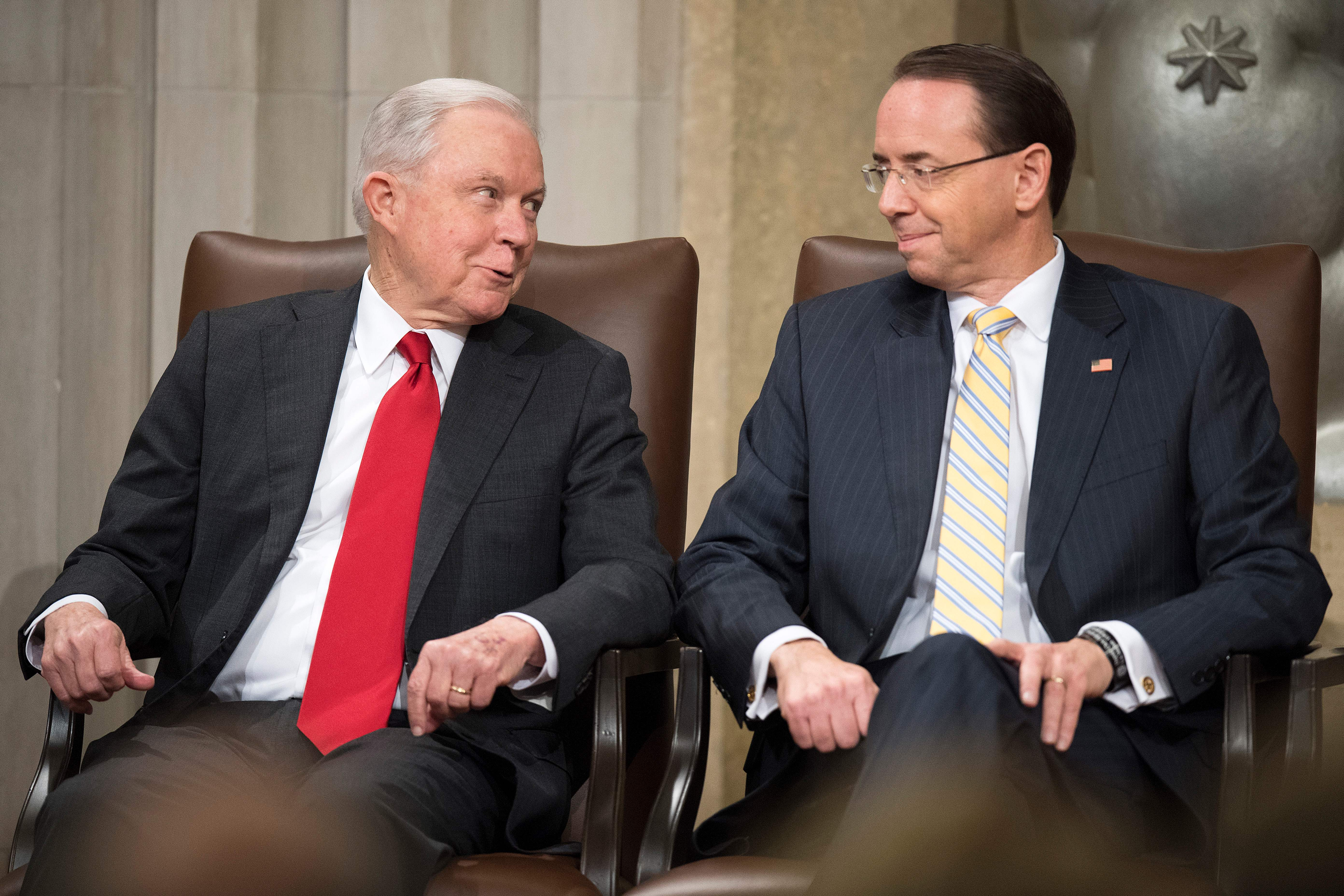 US Attorney General Jeff Sessions (L) and Deputy Attorney General Rod Rosenstein attend the US Marshal Service's Director's Honorary Awards ceremony in Washington, DC, on November 1, 2018. (Photo by Jim WATSON / AFP)