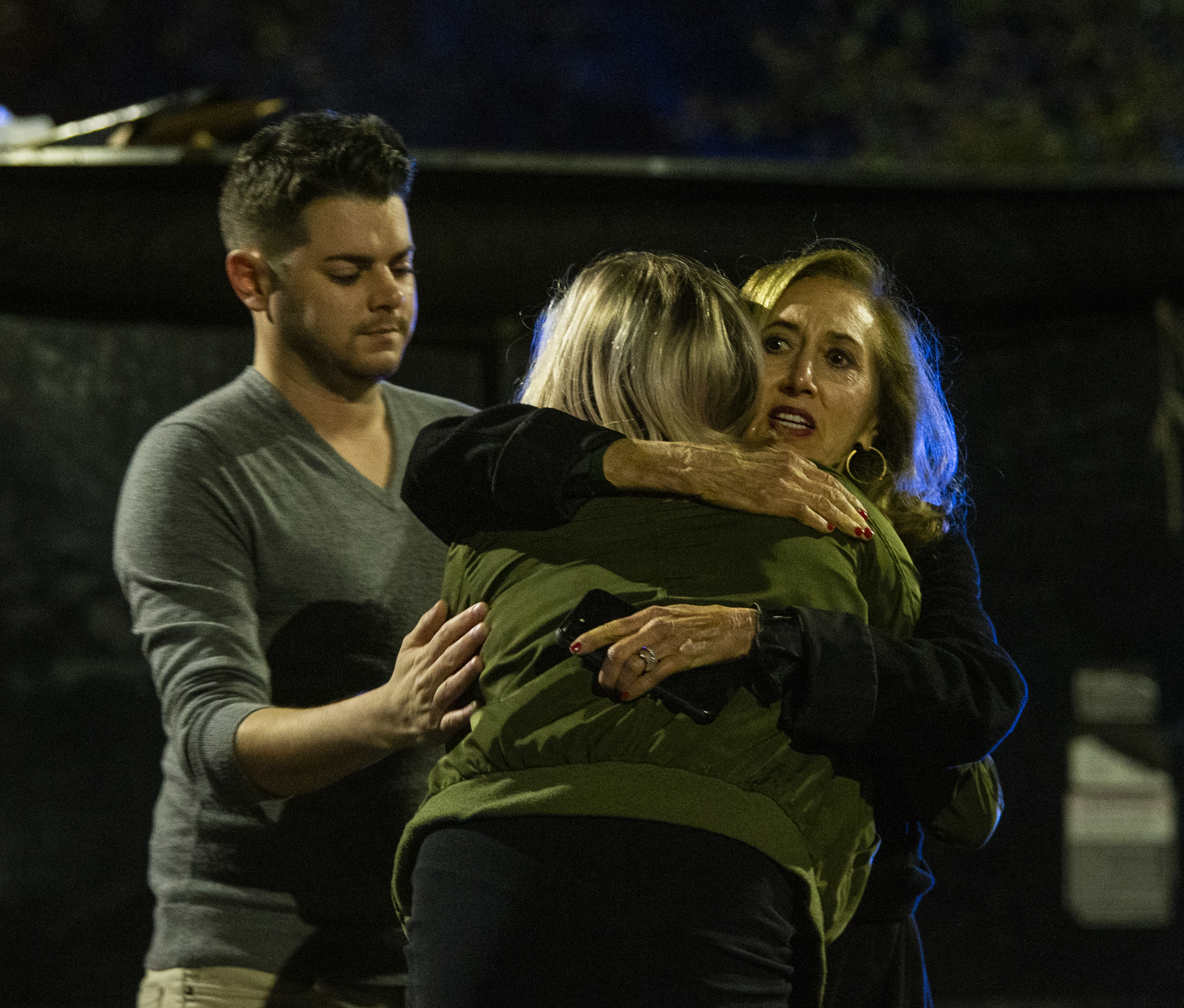 Matthew Rodin, left and Susan Turner comfort Melissa Hutchinson who rendered aid to some of the victims of a mass shooting November 2, 2018 in Tallahassee, Florida. Mark Wallheiser/Getty Images