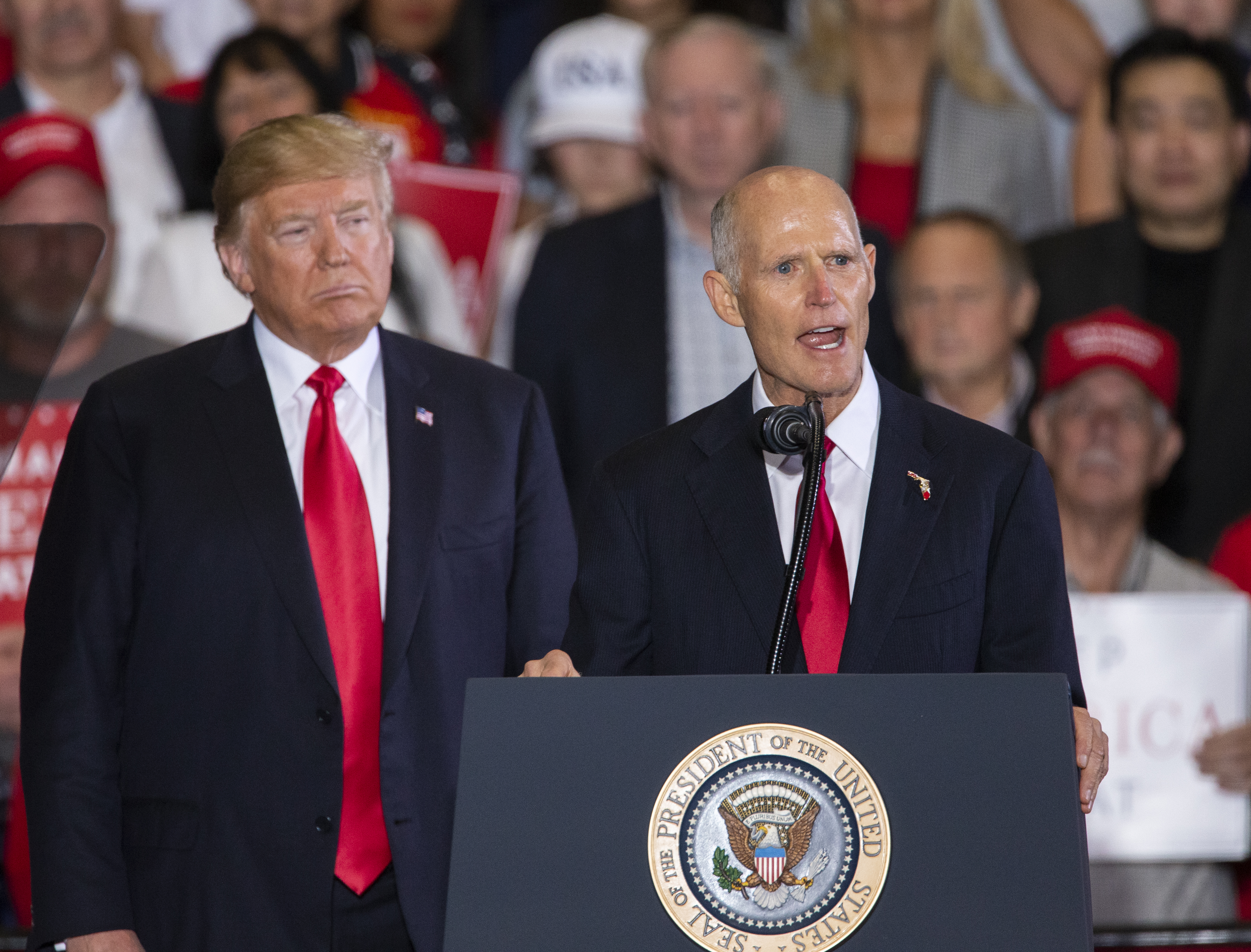 Florida governor and US senatorial candidate Rick Scott speaks with U.S. President Donald Trump at a campaign rally at the Pensacola International Airport on November 3, 2018 in Pensacola, Florida. Mark Wallheiser/Getty Images