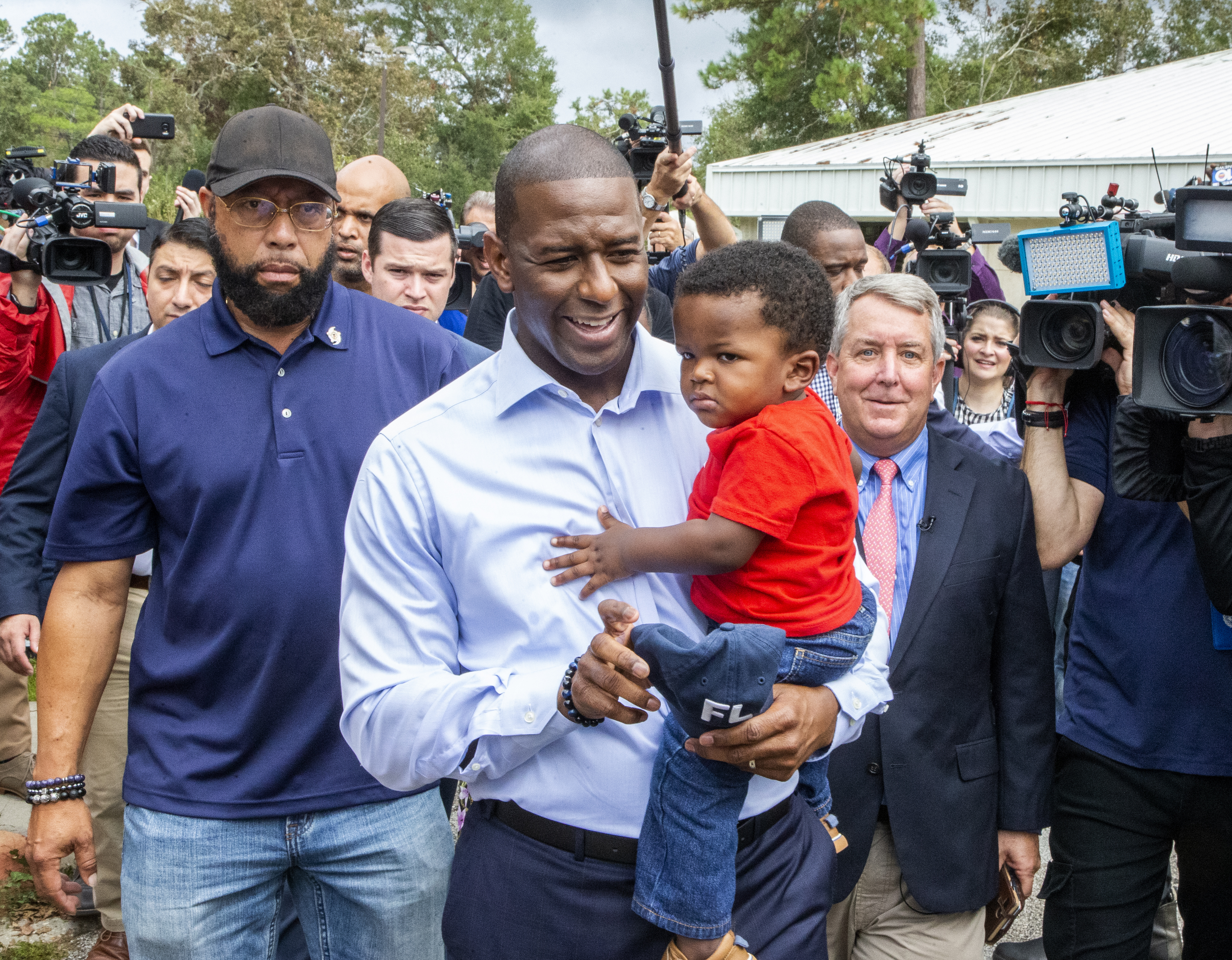 TALLAHASSEE, FL - NOVEMBER 06: Tallahassee mayor and Florida Democratic gubernatorial candidate Andrew Gillum, with his one year old son Davis, walks out after casting his ballot on November 6, 2018 in Tallahassee, Florida. Gillum is in a close race against Republican candidate Ron DeSantis. (Photo by Mark Wallheiser/Getty Images)