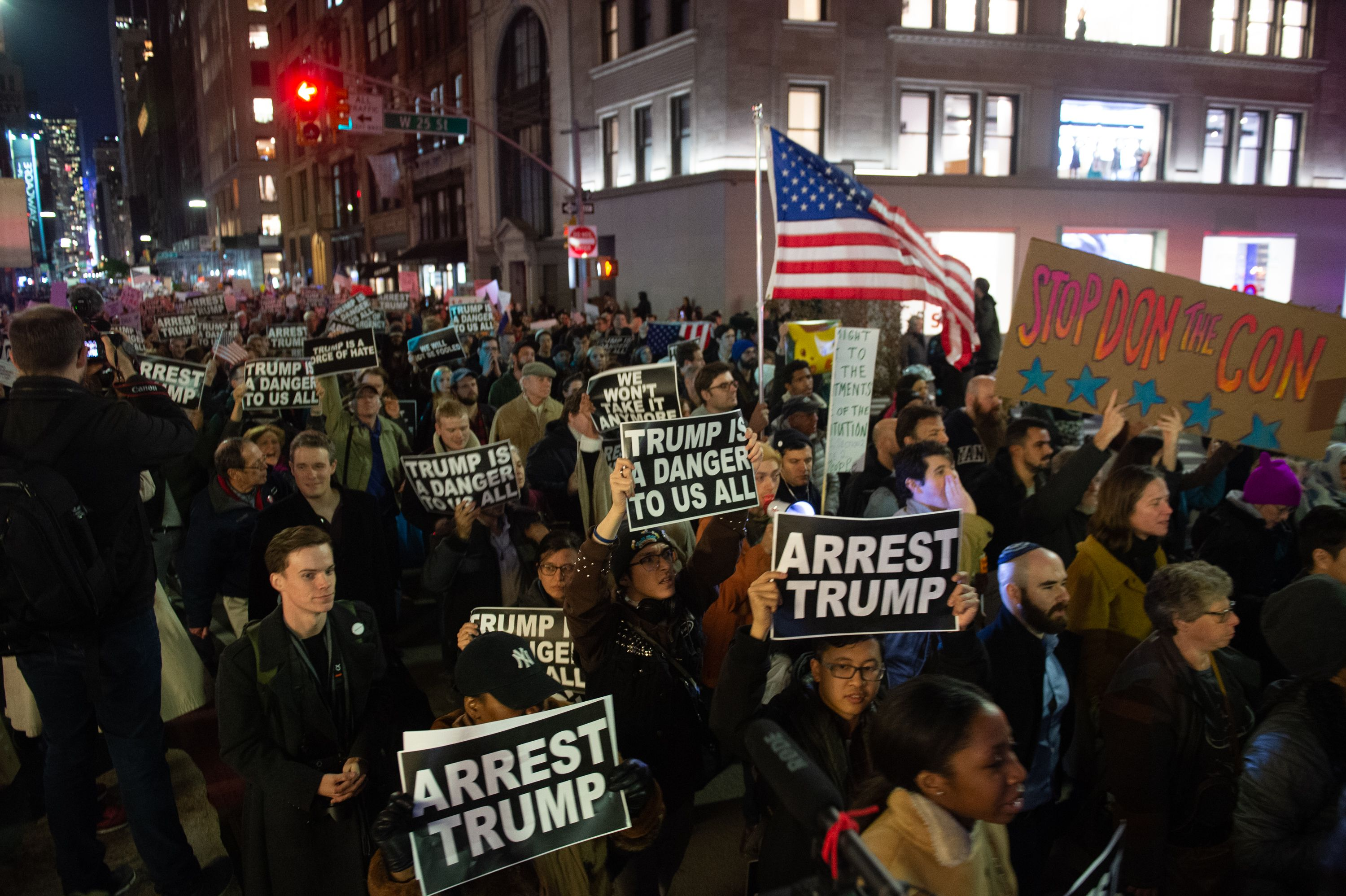 People protest and march against US President Donald Trump's alleged interference in Robert Mueller's investigation in New York City on November 8, 2018. - President Donald Trump was accused on November 8, 2018, of pushing America toward a constitutional crisis after his firing of the attorney general cast doubt over the future of an explosive probe into election collusion with Russian agents. (Photo by Bryan R. Smith / AFP) (Photo credit should read BRYAN R. SMITH/AFP/Getty Images)
