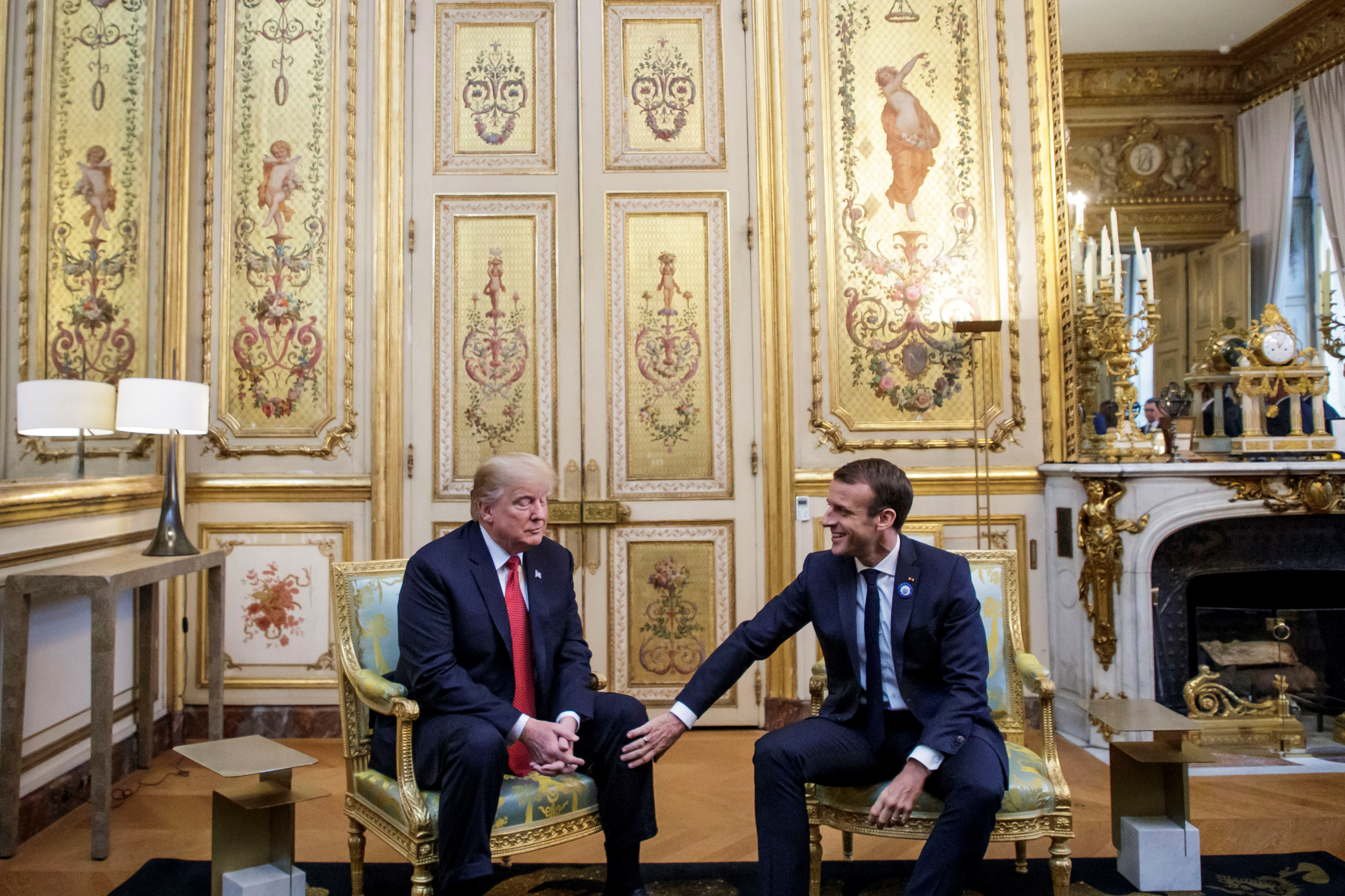 US President Donald Trump (L) speaks with French president Emmanuel Macron prior to their meeting at the Elysee Palace in Paris on November 10, 2018, on the sidelines of commemorations marking the 100th anniversary of the 11 November 1918 armistice, ending World War I. (Photo by Christophe Petit-Tesson / POOL / AFP)