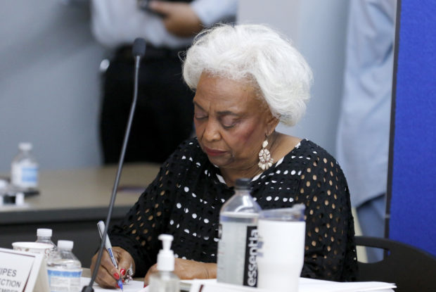 LAUDERHILL, FL - NOVEMBER 10: Dr. Brenda Snipes, Broward County Supervisor of Elections, signs results with other canvassing board members after they were transmitted to the state capital on November 10, 2018 in Lauderhill, Florida. Three close midterm election races for governor, senator, and agriculture commissioner are expected to be recounted in Florida.(Photo by Joe Skipper/Getty Images)