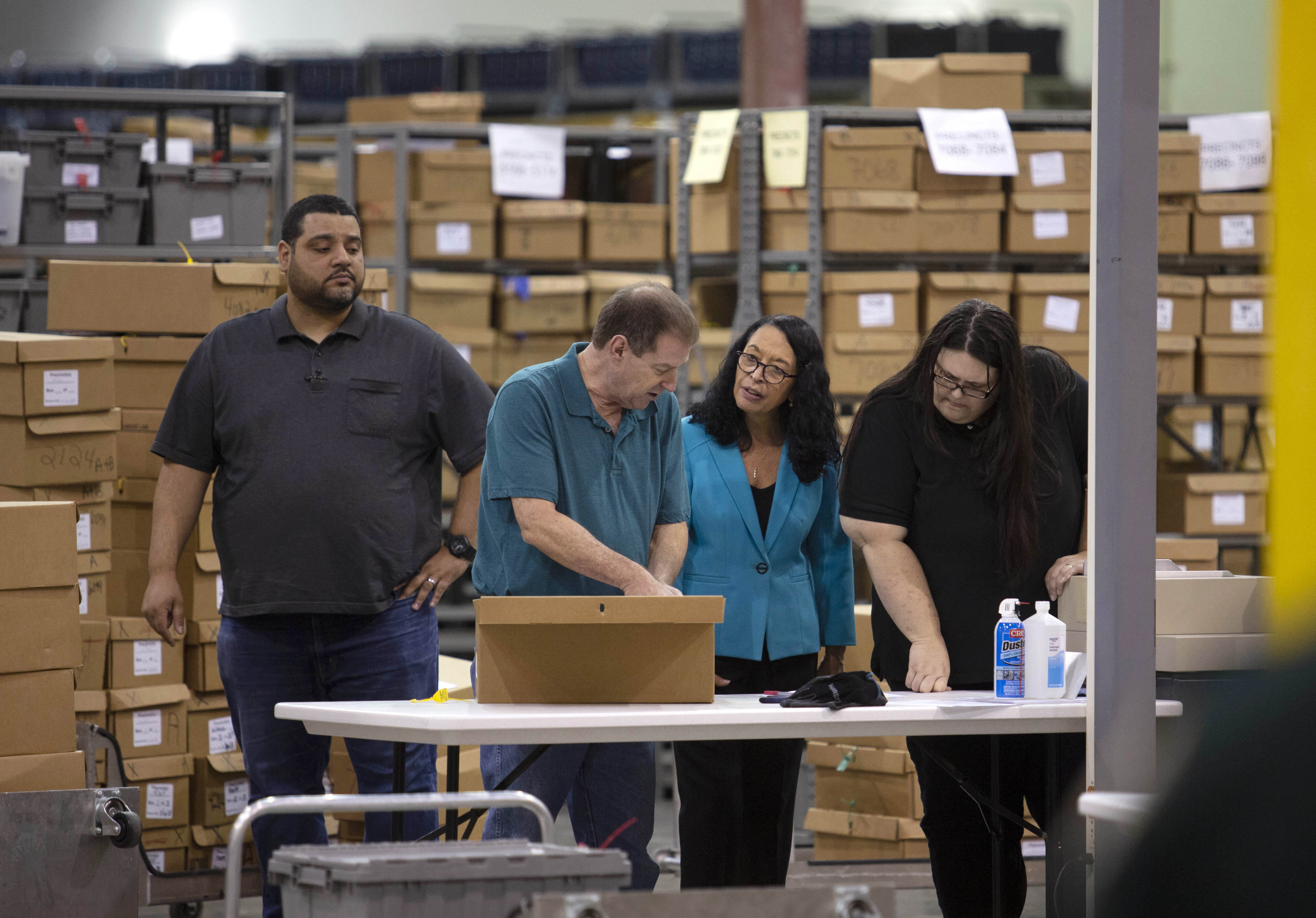 PALM BEACH, FL - NOVEMBER 15: Palm Beach County Supervisor of Elections Susan Bucher (C-R) supervises workers that are preparing to feed ballots through machines at the Supervisor of Elections Service Center on November 15, 2018 in Palm Beach, Florida. After ballot-counting machines overheated in Palm Beach County on Tuesday forcing a restart of vote counting, the county remains one of the last to finish their recount. (Photo by Saul Martinez/Getty Images)