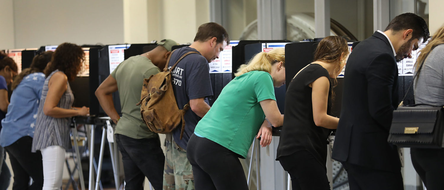 MIAMI, FLORIDA - NOVEMBER 06: Voters fill out their ballots as they cast their vote at a polling station setup in Legion Park for the mid-term election on November 06, 2018 in Miami, Florida. The political races for the Senate and House are being hotly contested across the country. (Photo by Joe Raedle/Getty Images)