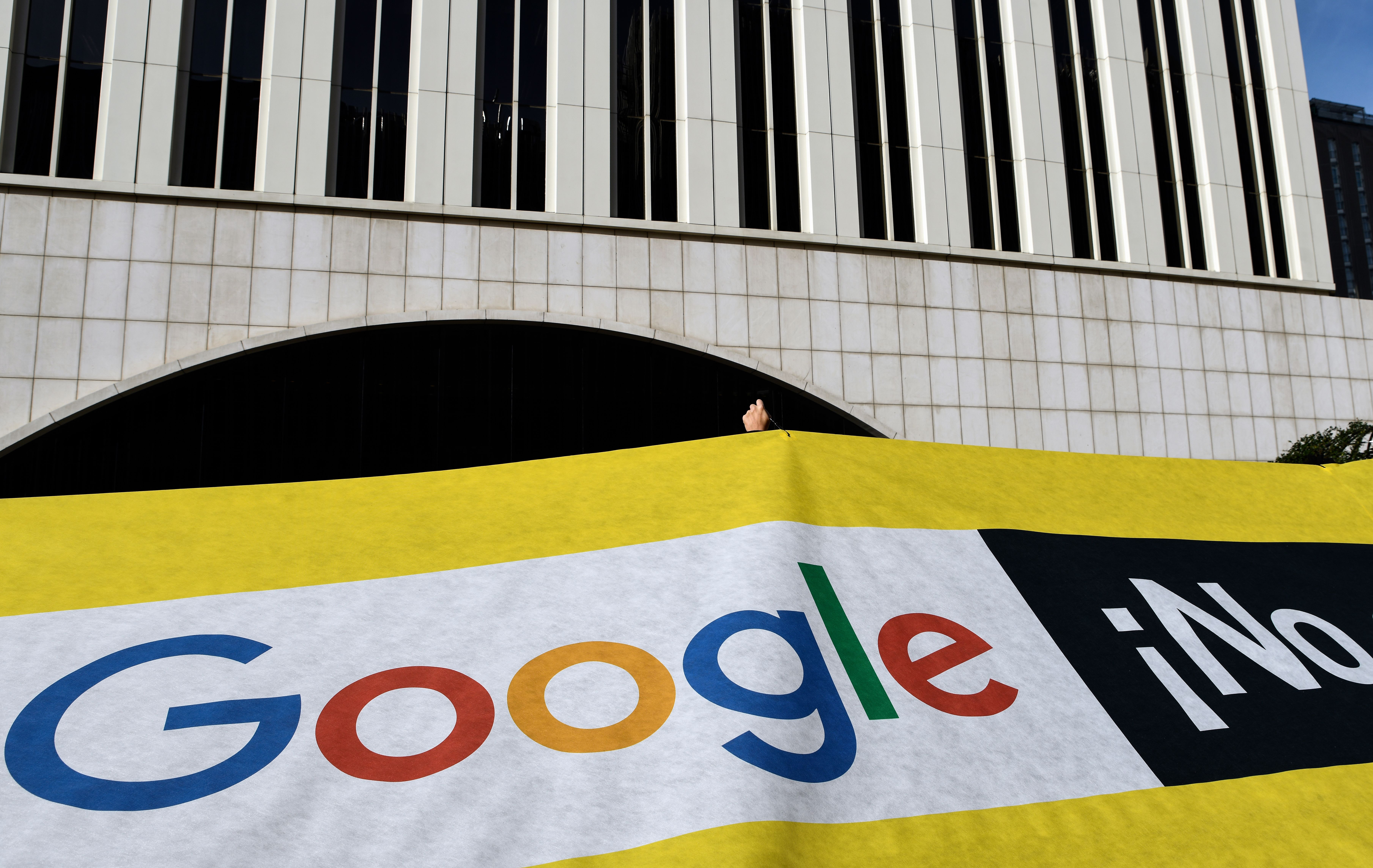 Amnesty International activists gather for a protest outside the Google headquarters in Madrid on November 27, 2018 as part of a campaign calling on Google to cancel its controversial plan to launch a censored search engine in China. OSCAR DEL POZO/AFP/Getty Images
