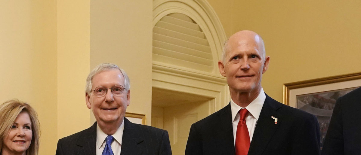 U.S. Senate Majority Leader Sen. Mitch McConnell poses for photos with Republican U.S. Senate candidate for Florida and incumbent Florida Gov. Rick Scott during a photo-op at the U.S. Capitol November 14, 2018 in Washington, DC. Sen. Alex Wong/Getty Images
