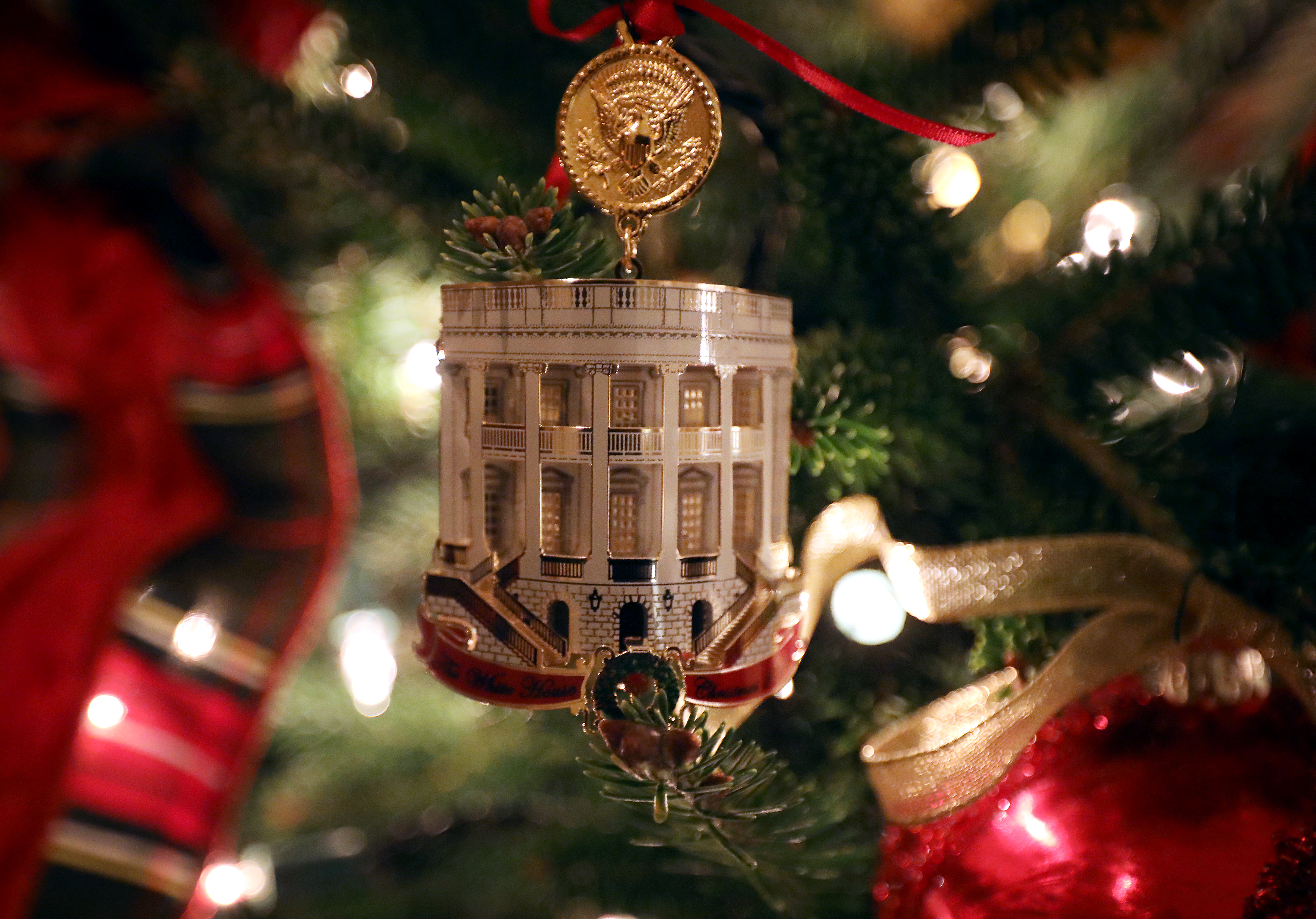 WASHINGTON, DC - NOVEMBER 26: The White House Historical Association Official 2018 White House Christmas Ornament hangs on a tree in the Library at the White House November 26, 2018 in Washington, DC. The 2018 theme of the White House holiday decorations is 'American Treasures,' and features patriotic displays highlighting the country's 'unique heritage.' The White House expects to host 100 open houses and more than 30,000 guests who will tour the topiary trees, architectural models of major U.S. cities, the Gold Star family tree and national monuments in gingerbread. (Photo by Chip Somodevilla/Getty Images)