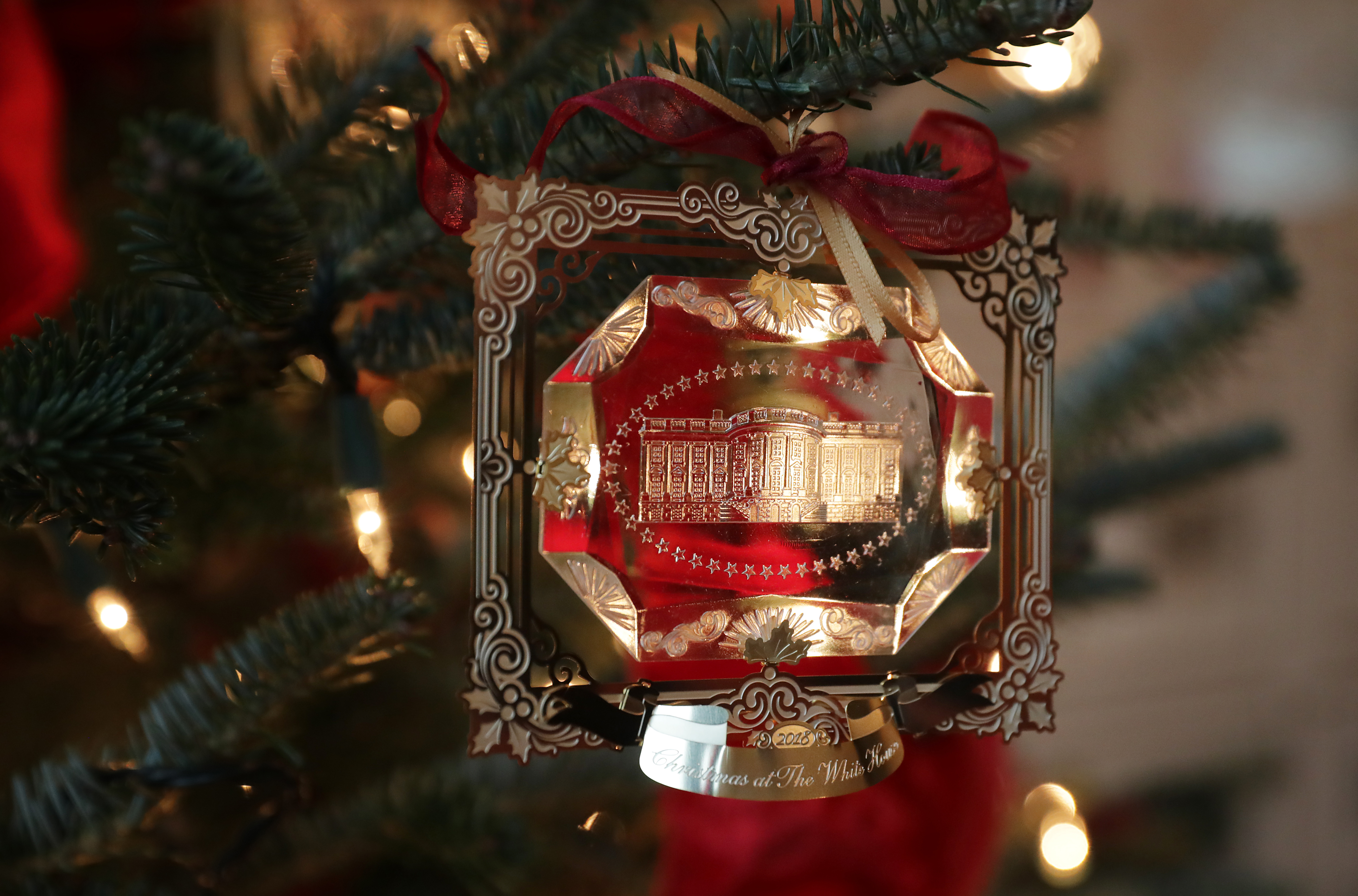 WASHINGTON, DC - NOVEMBER 26: The First Family's official Christmas ornament is displayed at the White House November 26, 2018 in Washington, DC. The 2018 theme of the White House holiday decorations is 'American Treasures,' and features patriotic displays highlighting the country's 'unique heritage.' The White House expects to host 100 open houses and more than 30,000 guests who will tour the topiary trees, architectural models of major U.S. cities, the Gold Star family tree and national monuments in gingerbread. (Photo by Chip Somodevilla/Getty Images)