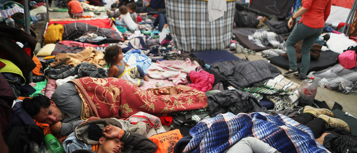 TIJUANA, MEXICO - NOVEMBER 26: Members of the 'migrant caravan' rest in a temporary shelter set up for members of the caravan on November 26, 2018 in Tijuana, Mexico. Around 6,000 migrants from Central America have arrived in the city with the mayor of Tijuana declaring the situation a 'humanitarian crisis'. (Photo by Mario Tama/Getty Images)