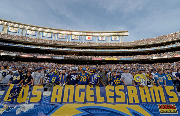 """SAN DIEGO, CA - NOVEMBER 23: Fans of the St. Louis Rams hold a """"Los Angeles Rams"""" sign against the San Diego Chargers during their NFL Game on November 23, 2014 in San Diego, California. (Photo by Donald Miralle/Getty Images)"""