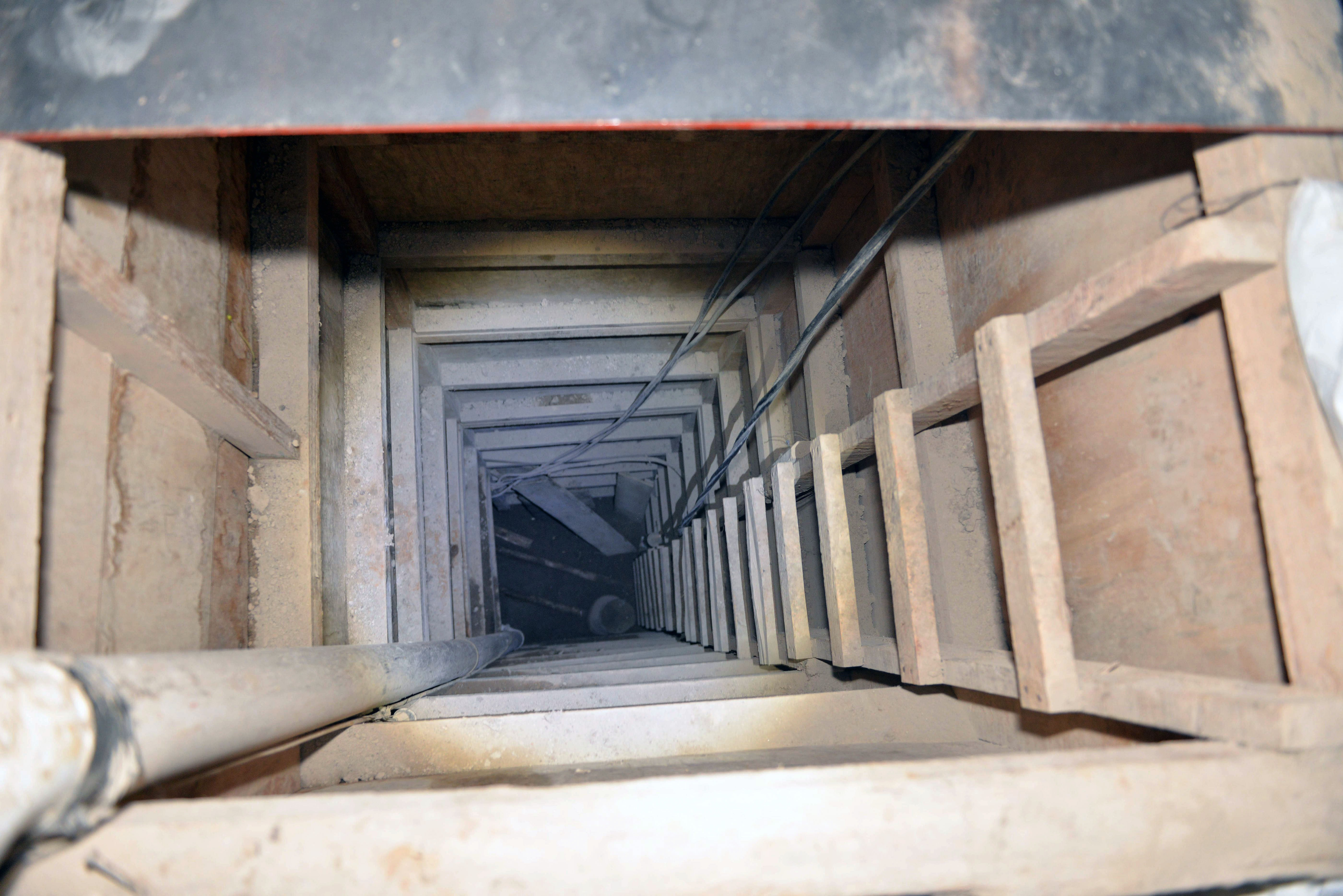"Picture of the presumed end of the tunnel through which Mexican drug lord Joaquin ""El Chapo"" Guzman might have escaped from the Altiplano prison, in a house in Almoloya de Juarez, Mexico, on July 14, 2015. MARIO VAZQUEZ/AFP/Getty Images"