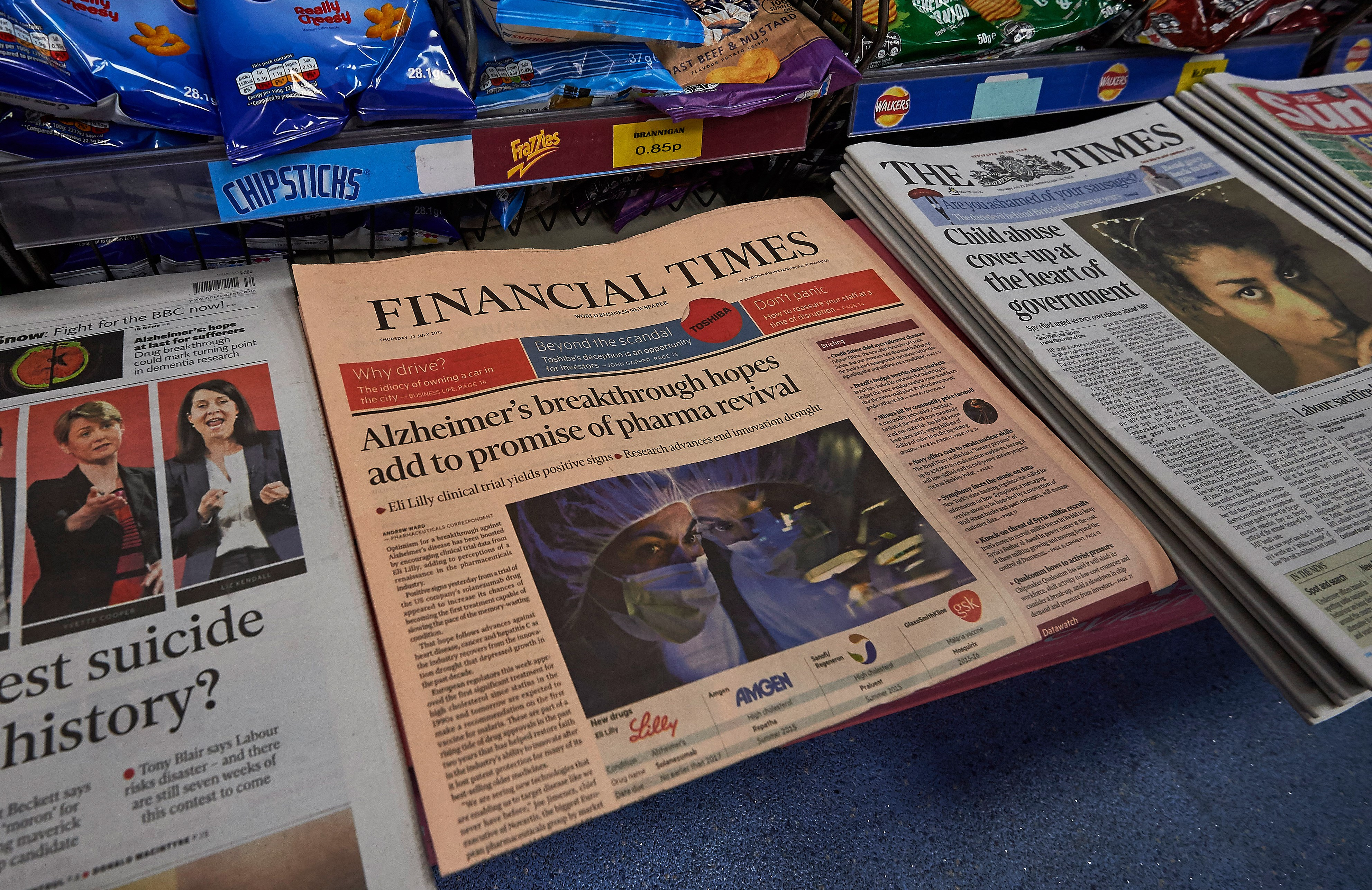 "A copy of the Financial Times newspaper is seen alongside other British newspapers displayed for sale in a newsagents in London on July 23, 2015. British publisher Pearson revealed today it is in ""advanced"" talks to sell its flagship business newspaper the Financial Times to an unnamed suitor. AFP PHOTO / NIKLAS HALLE'N"