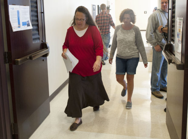 MOREHEAD, KY - SEPTEMBER 14: Rowan County clerk Kim Davis walks through the halls of the courthouse on her first day back to work, after being released from jail last week, at the Rowan County Courthouse September 14, 2015 in Morehead, Kentucky. Davis was jailed for disobeying a judges order for denying marriage licenses to gay couples on the basis of her religious faith. (Photo by Ty Wright/Getty Images)