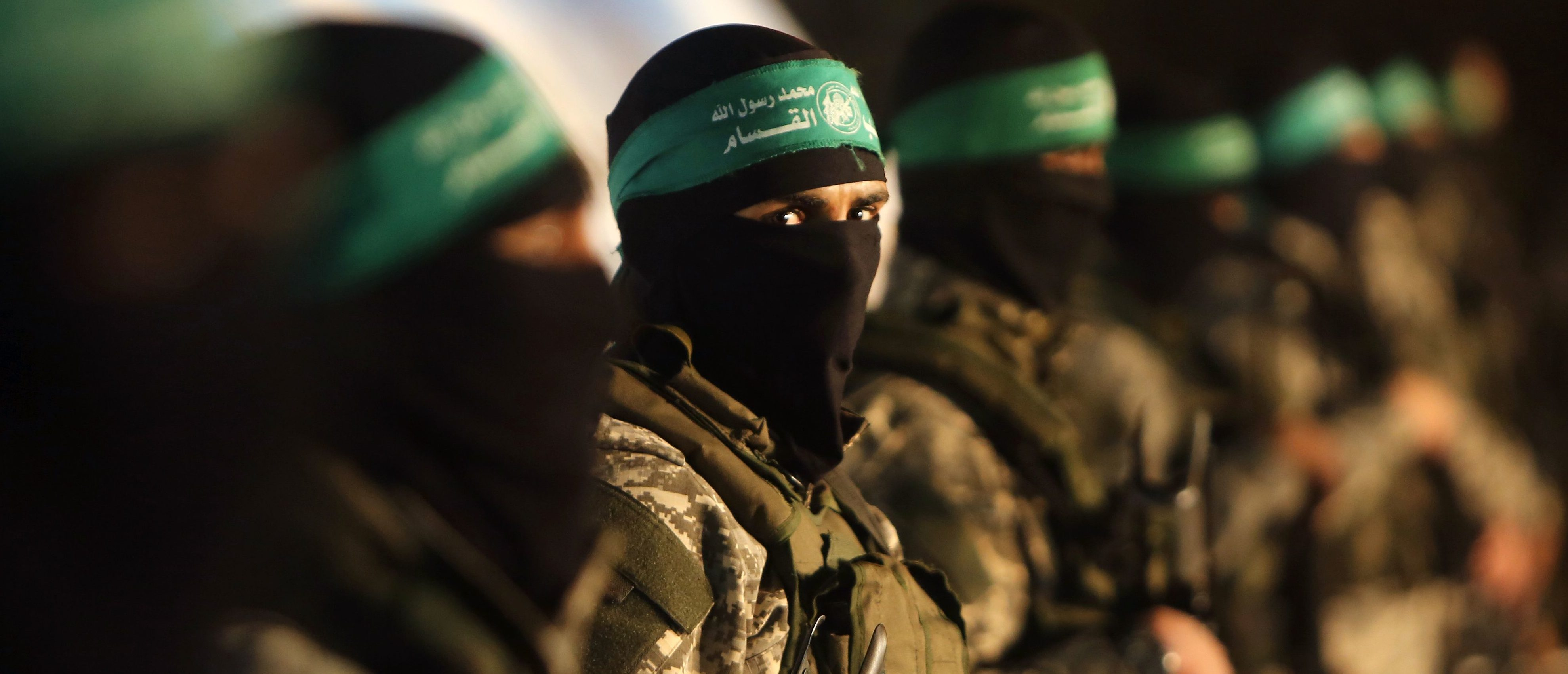TOPSHOT - Palestinian members of the Ezzedine al-Qassam Brigades, the armed wing of the Hamas movement, take part in a gathering on January 31, 2016 in Gaza city to pay tribute to their fellow militants who died after a tunnel collapsed in the Gaza Strip. Seven Hamas militants were killed on January 28, 2016 after a tunnel built for fighting Israel collapsed in the Gaza Strip, highlighting concerns that yet another conflict could eventually erupt in the Palestinian enclave. / AFP / MAHMUD HAMS (Photo credit should read MAHMUD HAMS/AFP/Getty Images)