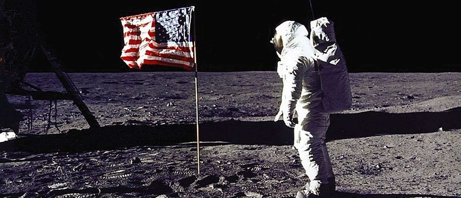 "DC, UNITED STATES: This 20 July 1969 file photo released by NASA shows astronaut Edwin E. ""Buzz"" Aldrin, Jr. saluting the US flag on the surface of the Moon during the Apollo 11 lunar mission. The 20th July 1999 marks the 30th anniversary of the Apollo 11 mission and man's first walk on the Moon. AFP PHOTO NASA (Photo credit should read NASA/AFP/Getty Images)"
