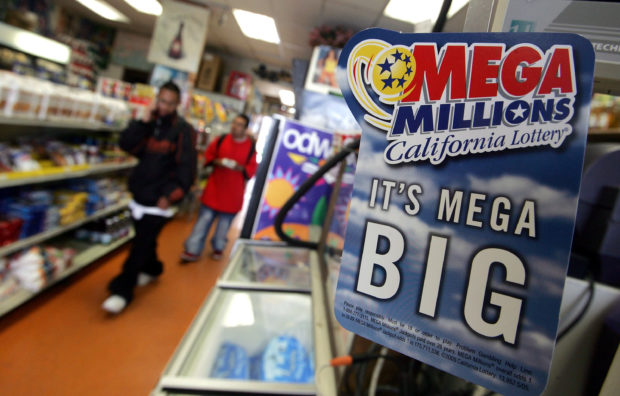 SAN FRANCISCO - JUNE 23: An advertisement for the Mega Millions lottery is seen June 23, 2005 in San Francisco, California. Retailers began to sell tickets for the high-jackpot Mega Millions game on Wednesday after the state Lottery Commission voted to join 11 other states in the Mega Millions game in an attempt to boost stagnant sales and bring in more money for schools. The game was promoted as a way to regularly bring $100 million jackpots to California, while still offering the SuperLotto Plus game. (Photo by Justin Sullivan/Getty Images)