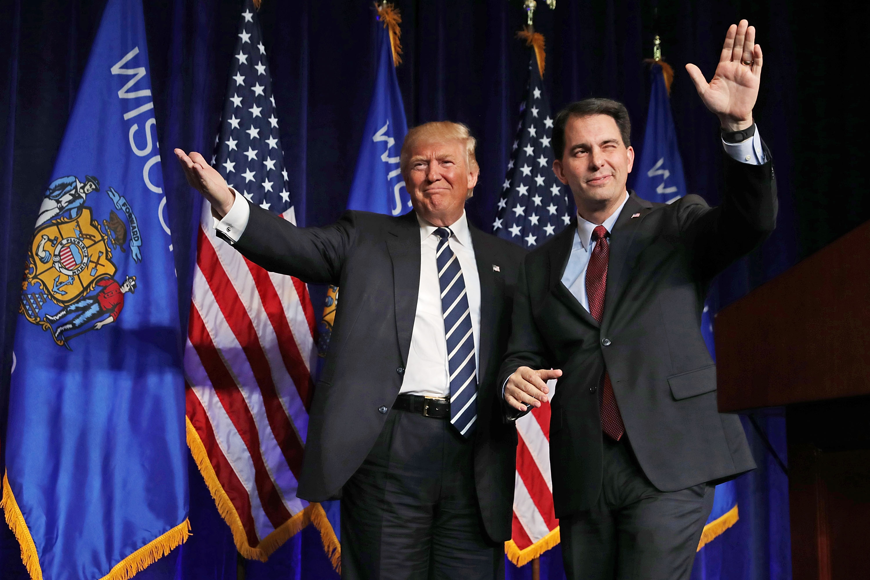 Republican presidential nominee Donald Trump (L) is welcomed to the stage by outgoing Wisconsin Governor Scott Walker during a campaign rally at the W.L. Zorn Arena November 1, 2016 in Altoona, Wisconsin. Chip Somodevilla/Getty Images