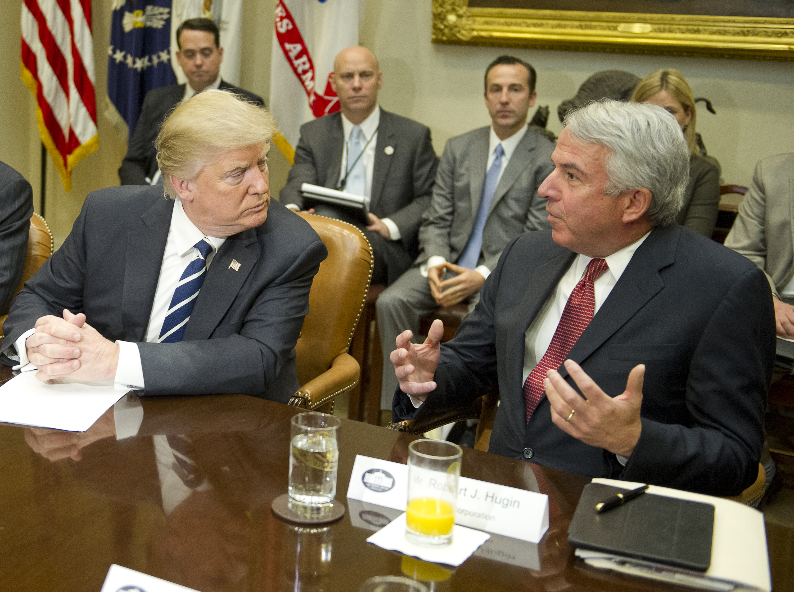 "WASHINGTON, DC - JANUARY 31: (AFP OUT) (L-R) U.S. President Donald Trump listens to Robert J. Hugin, Executive Chairman of the Celgene Corporation during a meeting with representatives from PhRMA, the Pharmaceutical Research and Manufacturers of America in the Roosevelt Room of the White House on January 31, 2017 in Washington, DC. According to its website PhRMA ""represents the country's leading biopharmaceutical researchers and biotechnology companies."" (Photo by Ron Sachs - Pool/Getty Images)"