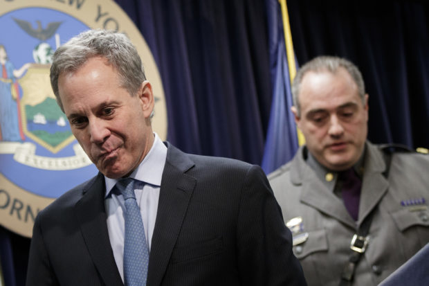 NEW YORK, NY - MARCH 15: New York state Attorney General Eric Schneiderman (L) leaves the podium after speaking during a news conference to announce the take down of a large organized crime ring, March 15, 2017 in New York City. The investigation, dubbed Operation Sticky Fingers, has resulted in charges against 12 people accused of stealing more than $12 million in high-end electronics and supplies from retail stores and reselling the merchandise on Amazon and eBay. (Photo by Drew Angerer/Getty Images)