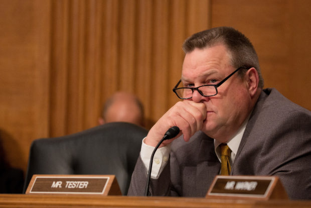 WASHINGTON, DC - MAY 18: U.S. Sen. Jon Tester (D-MT) listens to Treasury Secretary Steven Mnuchin at a Senate Banking Committee and International Policy hearing on Capital Hill May 18, 2017 in Washington, DC. Mnuchin spoke before the committee that oversees bank regulations in his first congressional testimony since being named as Treasury secretary. (Photo by Tasos Katopodis/Getty Images)