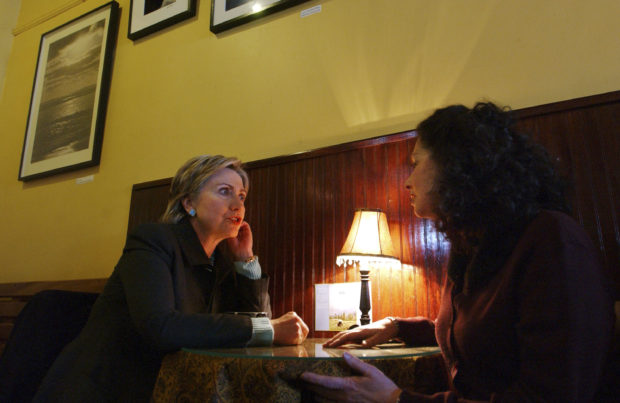 KEENE, NH - FEBRUARY 11: U.S. Senator Hillary Clinton (D-NY) visits with New Hampshire State Senator Molly Kelly (R) at Brewbakers coffee shop February 11, 2007 in Keene, New Hampshire. Clinton is in the Granite State for two days of campaigning, in her first visit to New Hampshire since declaring her candidacy for President. (Photo by Darren McCollester/Getty Images)