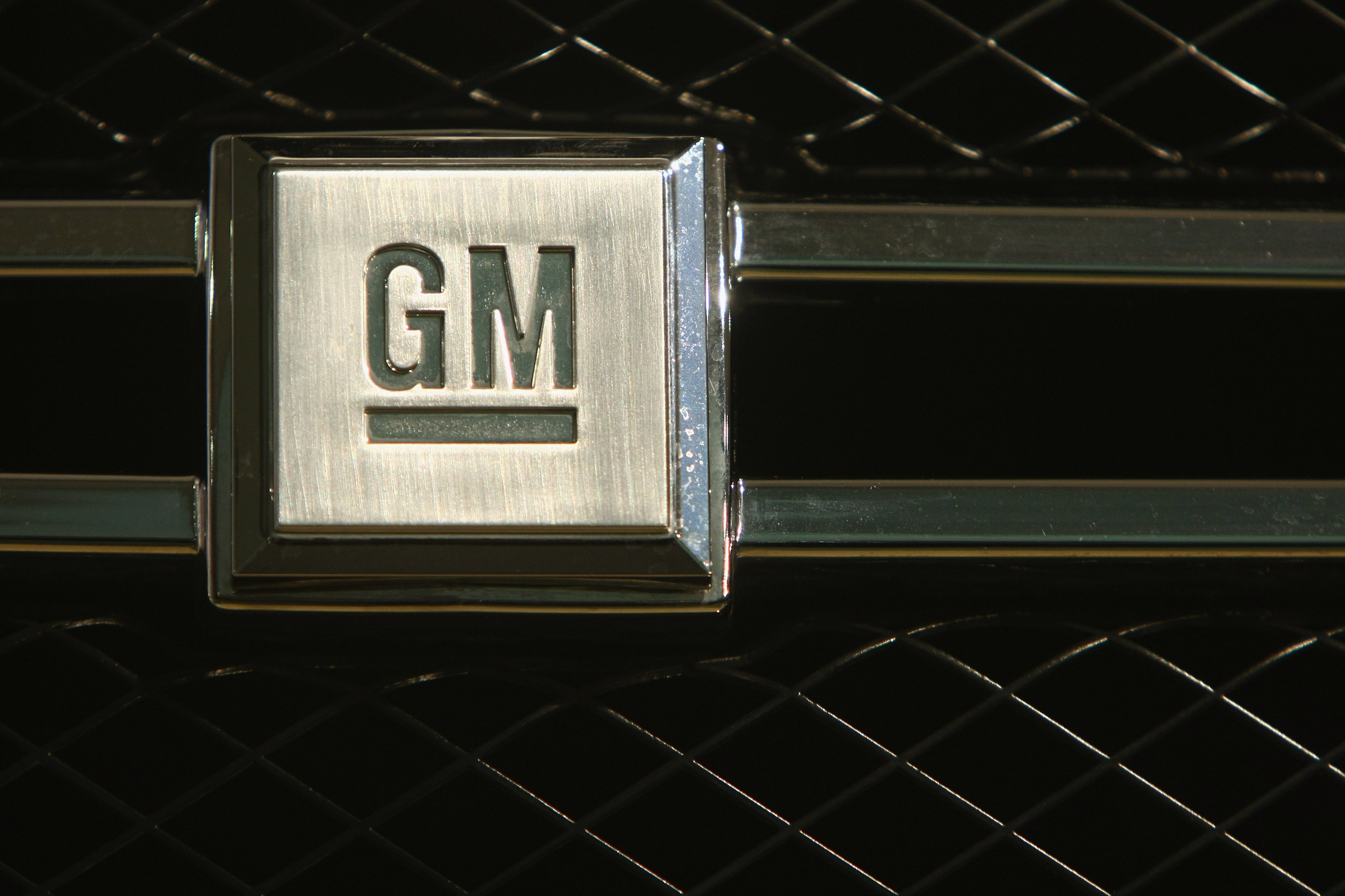 BERLIN - NOVEMBER 26: The logo of U.S. carmaker General Motors, or GM, is visible on the front grille of a GM Hydrogen 4 fuel cell-powered car at a presentation by Opel and GM on November 26, 2008 in Berlin, Germany. Opel, which is ownded by GM, has asked the German government for help in overcoming its difficulties resulting from the current financial crisis and the serious difficulties of GM. (Photo by Sean Gallup/Getty Images)