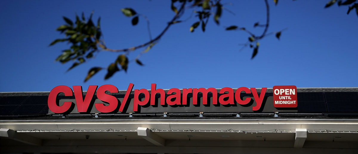 A sign is posted on the exterior of a CVS Pharmacy on December 4, 2017 in San Anselmo, California. Justin Sullivan/Getty Images