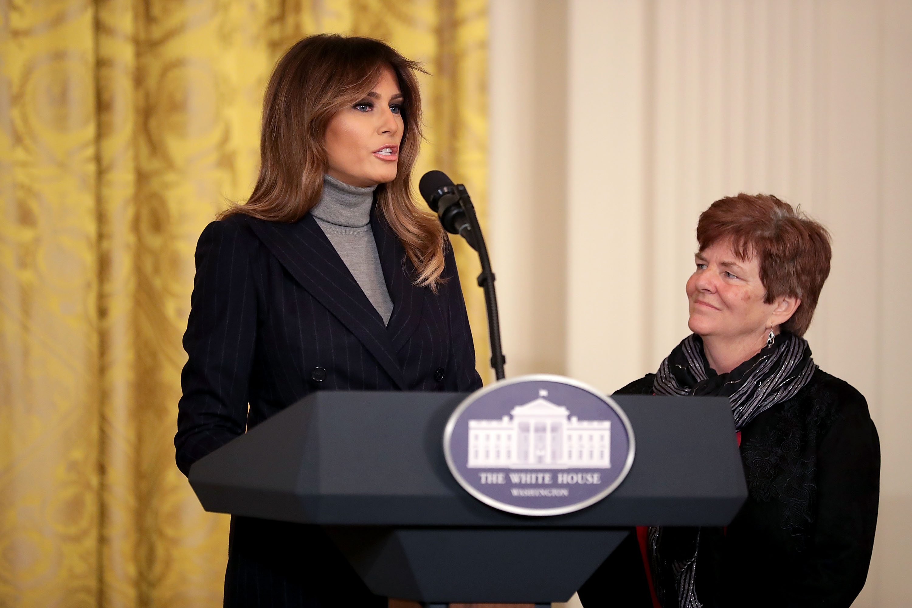 First lady Melania Trump reads from a letter that was sent to her by Betty Henderson (R), whose son died of an opioid overdose, during the White House Opioid Summit March 1, 2018 in Washington, DC. Chip Somodevilla/Getty Images