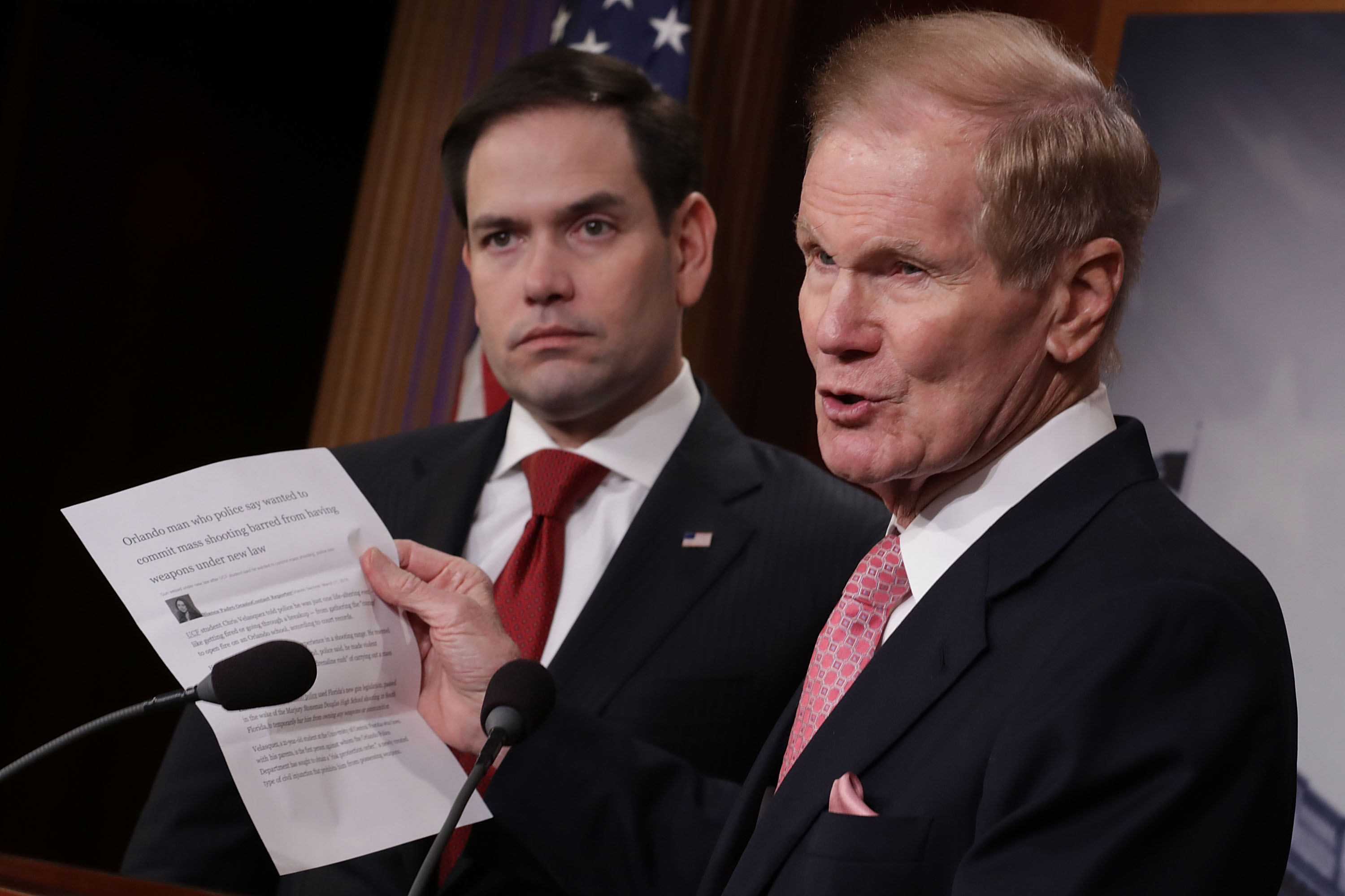 "Democratic Florida Sen. Bill Nelson (R) and Republican Florida Sen. Marco Rubio talk about their bipartisan legislation to create ""red flag"" gun laws during a news conference at the U.S. Capitol March 22, 2018 in Washington, DC. Chip Somodevilla/Getty Images"