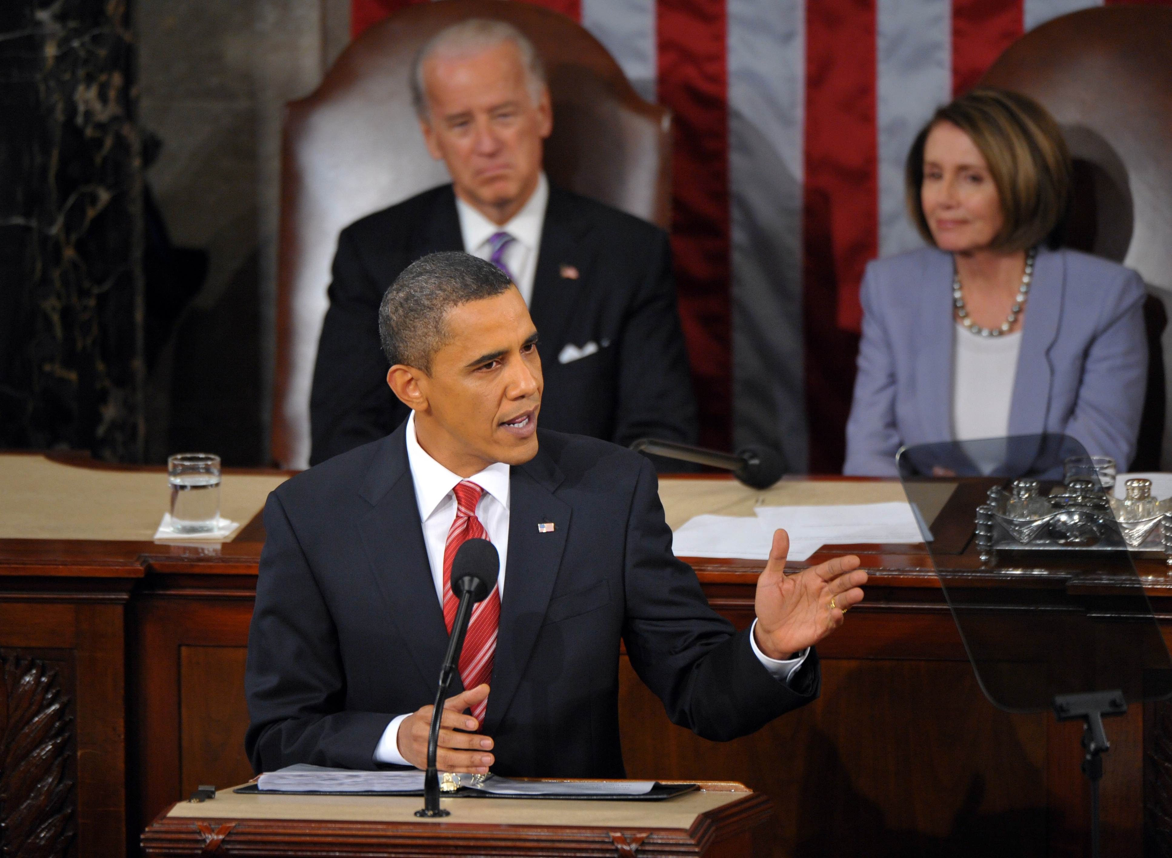 US President Barack Obama delivers his first State of the Union address January 27, 2010 at the US Capitol in Washington, DC. Obama declared that the worst of the economic storm had passed, but that a trail of devastation was left behind. Seated behind Obama is Vice President Joe Biden and House Speaker Nancy Pelosi. AFP PHOTO/Mandel NGAN (MANDEL NGAN/AFP/Getty Images)