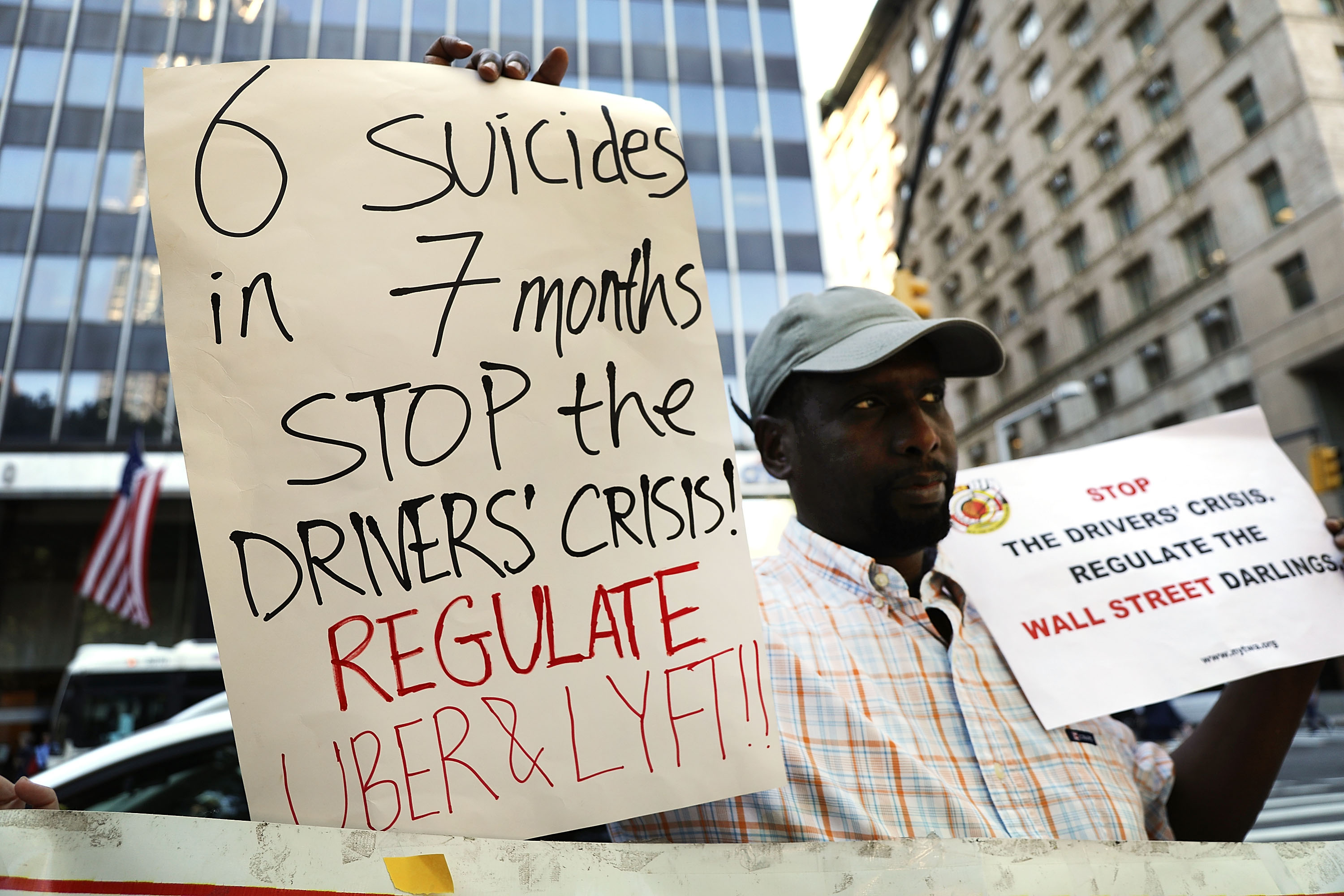 Taxi Driver Saibou Sidibe holds up a protest sign outside of city hall on June 19, 2018 in New York City. Spencer Platt/Getty Images