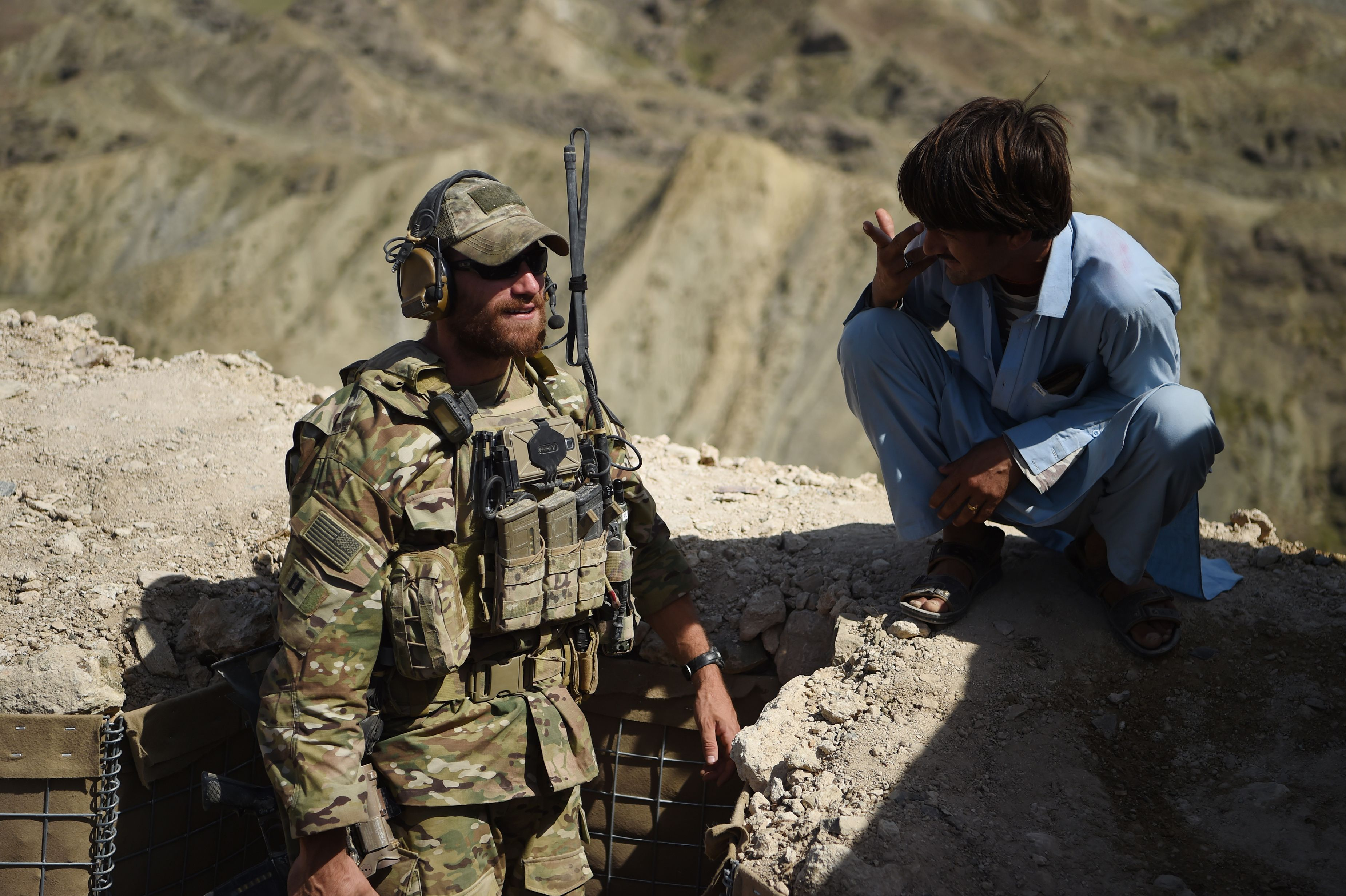 In this photo taken on July 7, 2018, A US Army soldier from NATO and an Afghan Local Police (ALP) look on in a checkpoint during a patrol against Islamic State militants at the Deh Bala district in the eastern province of Nangarhar Province. WAKIL KOHSAR/AFP/Getty Images