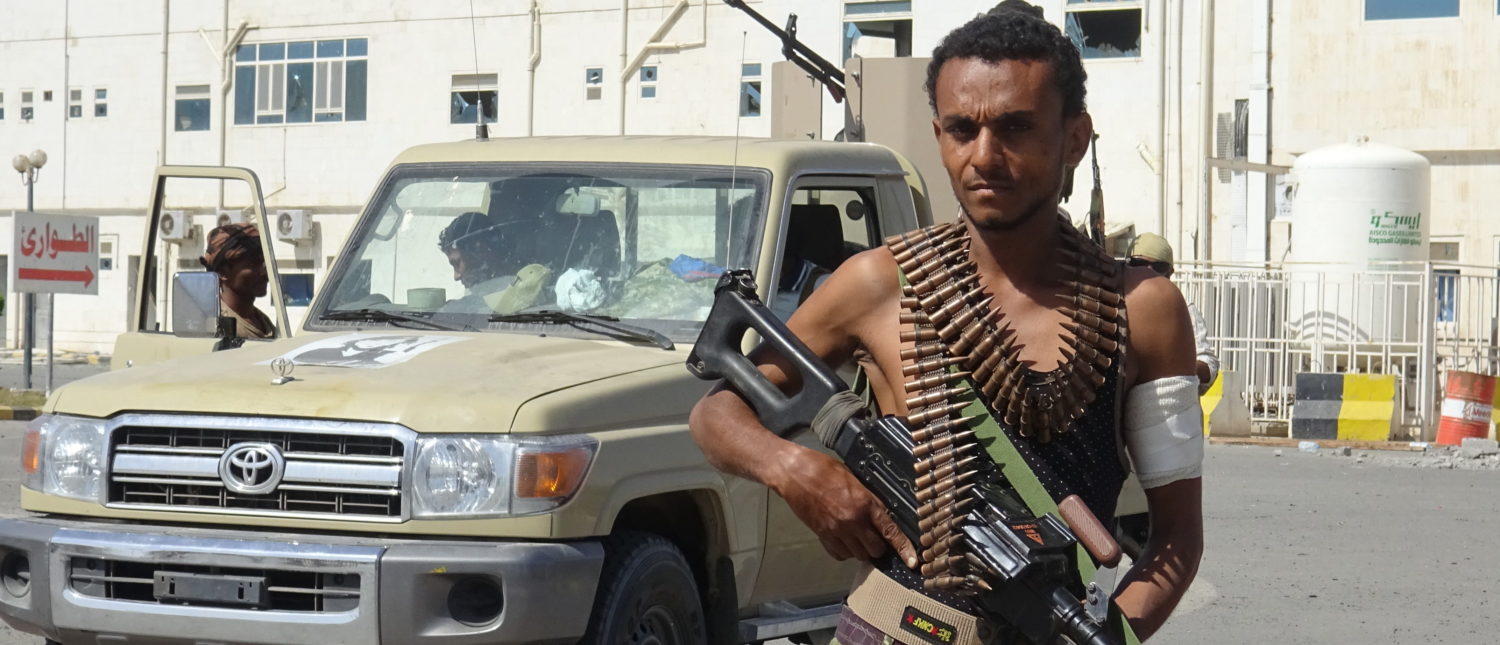 A member of the Yemeni pro-government forces is pictured in front of the May 22 Hospital on the eastern outskirts of port city of Hodeida on November 15, 2018. (Photo by STRINGER/AFP/Getty Images)